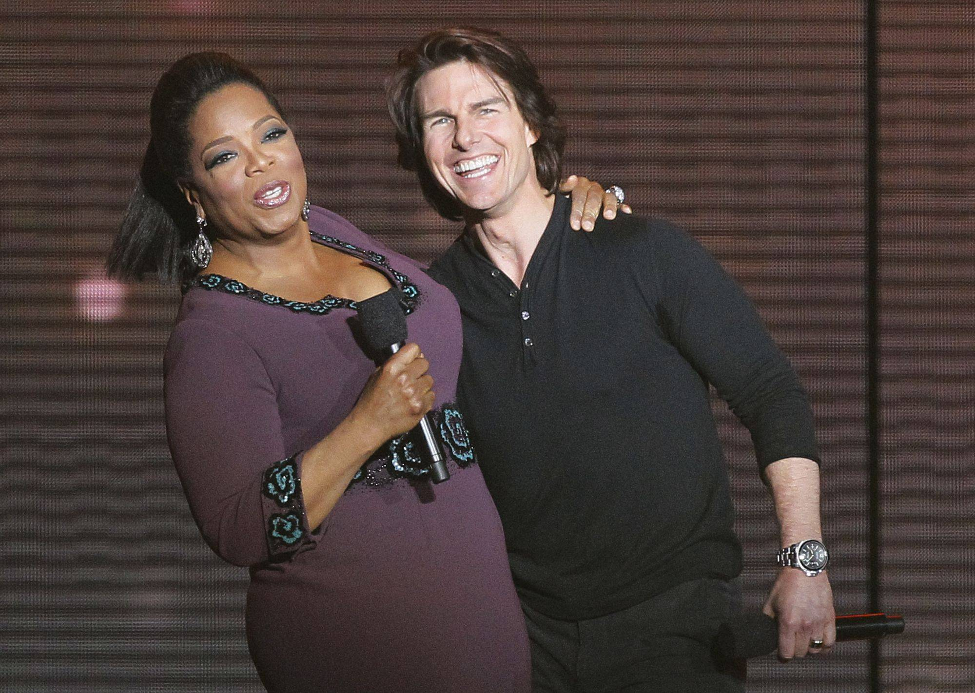 Tom Cruise, right, appears with Oprah Winfrey.