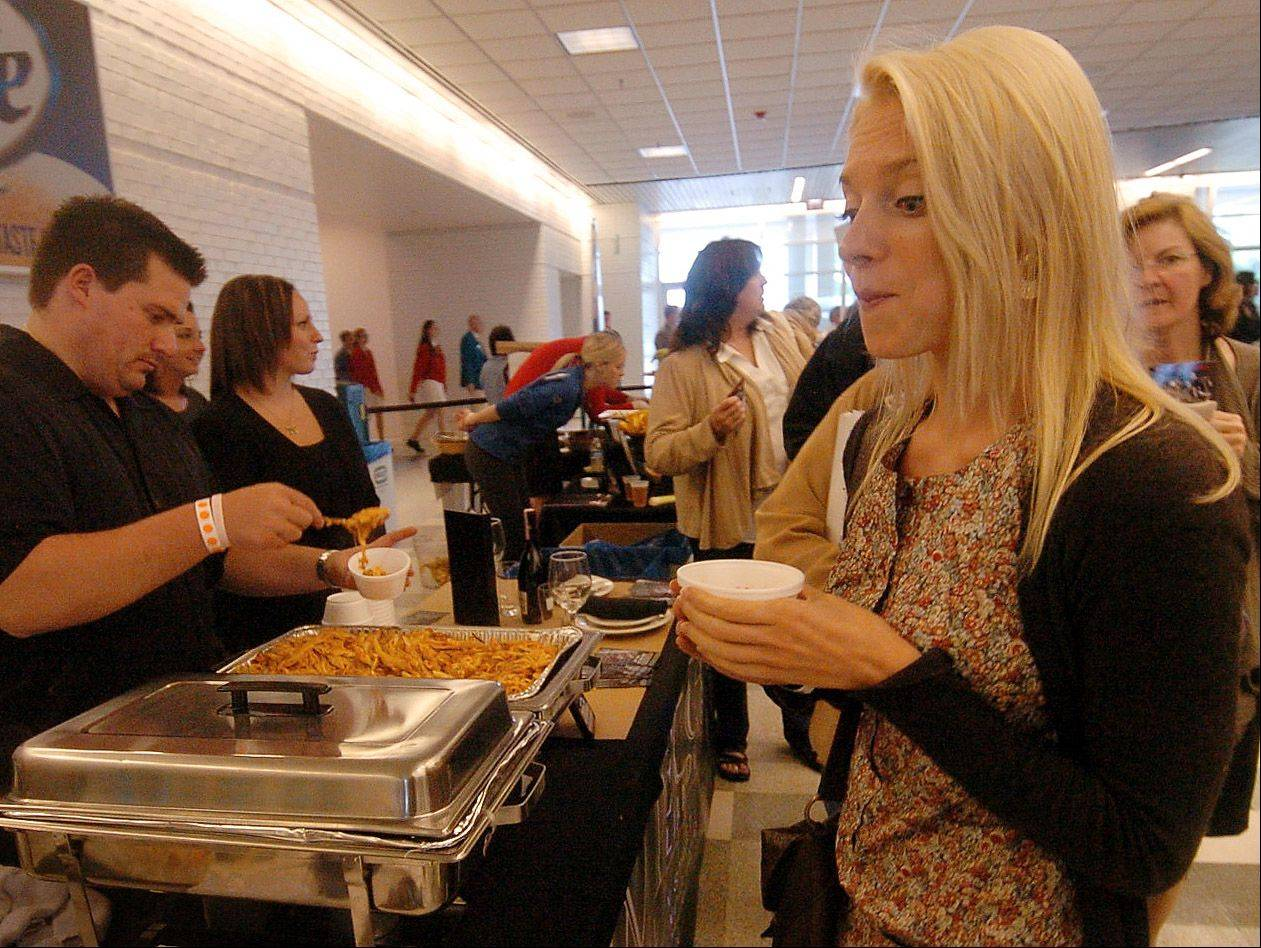 Vanessa Haig of Schaumburg tries the Penne Impecca from Impecca Casual Italian Dining in Roselle on Wednesday at Chefs' Fest at Arlington Park.