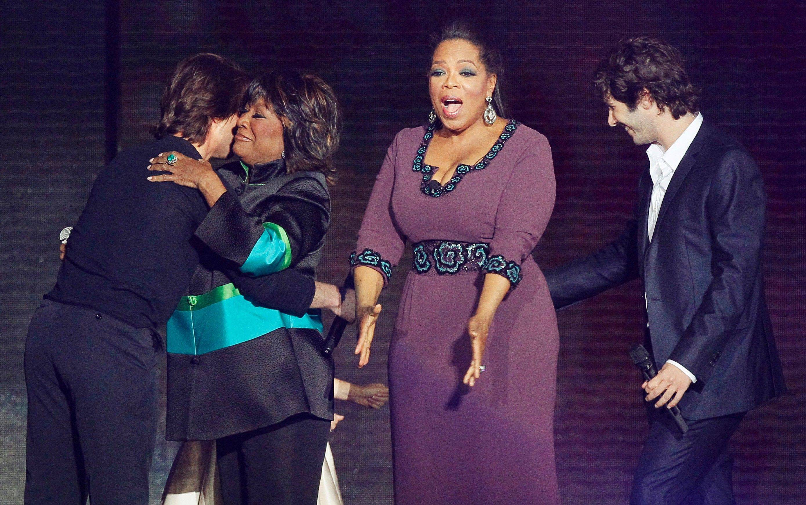 "Oprah Winfrey reacts as she is surrounded by Tom Cruise, left, Patti LaBelle and Josh Groban, right, during a star-studded double-taping of ""Surprise Oprah! A Farewell Spectacular,"" Tuesday in Chicago. ""The Oprah Winfrey Show"" is ending its run May 25, after 25 years, and millions of her fans around the globe are waiting to see how she will close out a show that spawned a media empire."