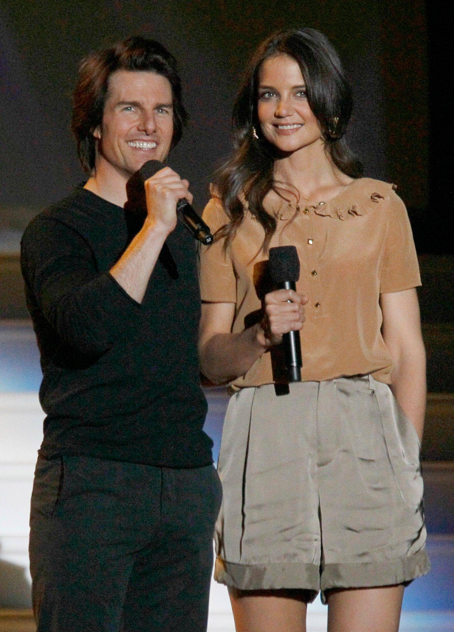 "Tom Cruise and Katie Holmes appear together during the final taping of ""The Oprah Winfrey Show"" in Chicago Tuesday."