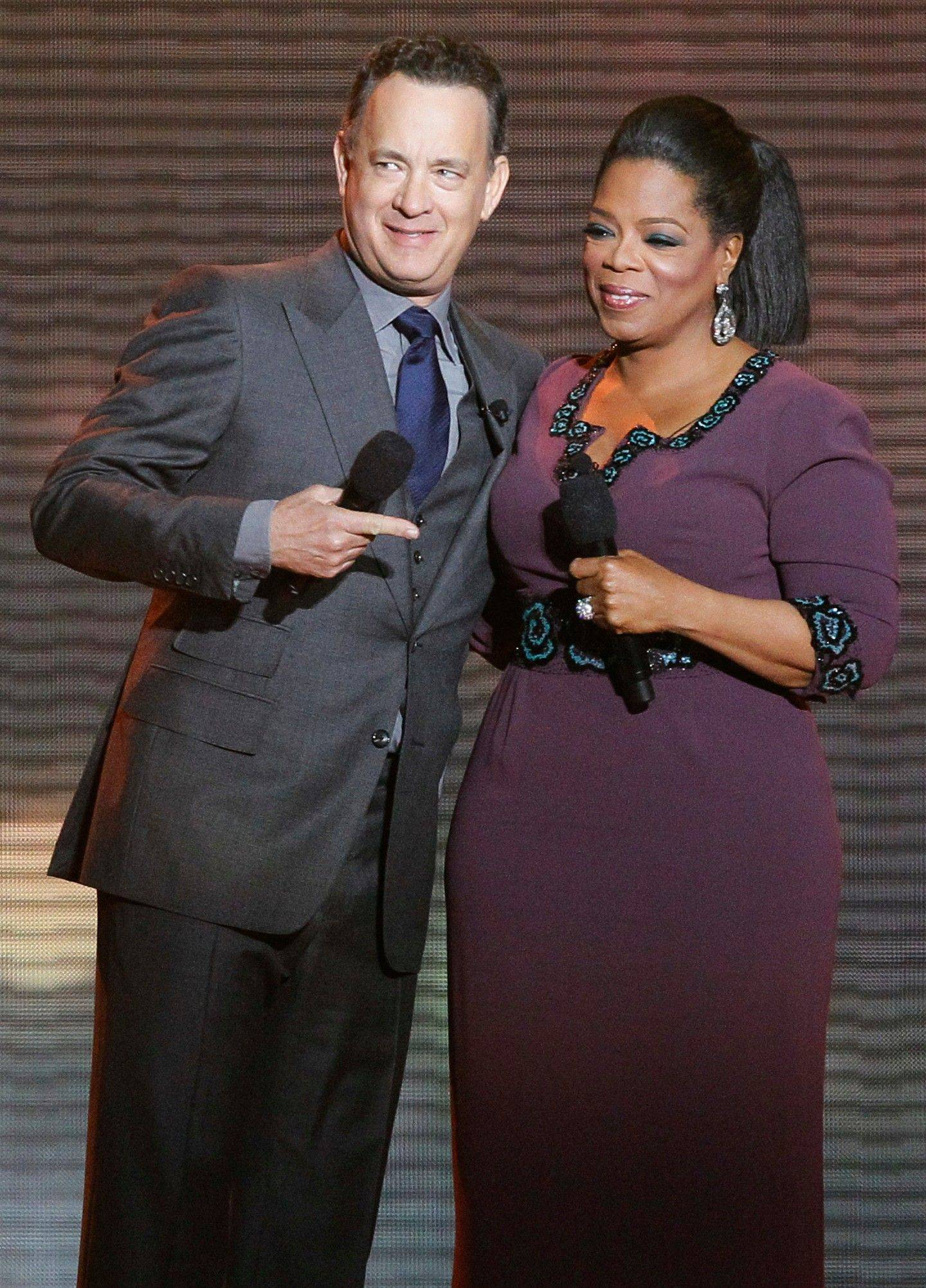 Tom Hanks appears with Oprah Winfrey during the star-studded double-taping of her final show Tuesday.