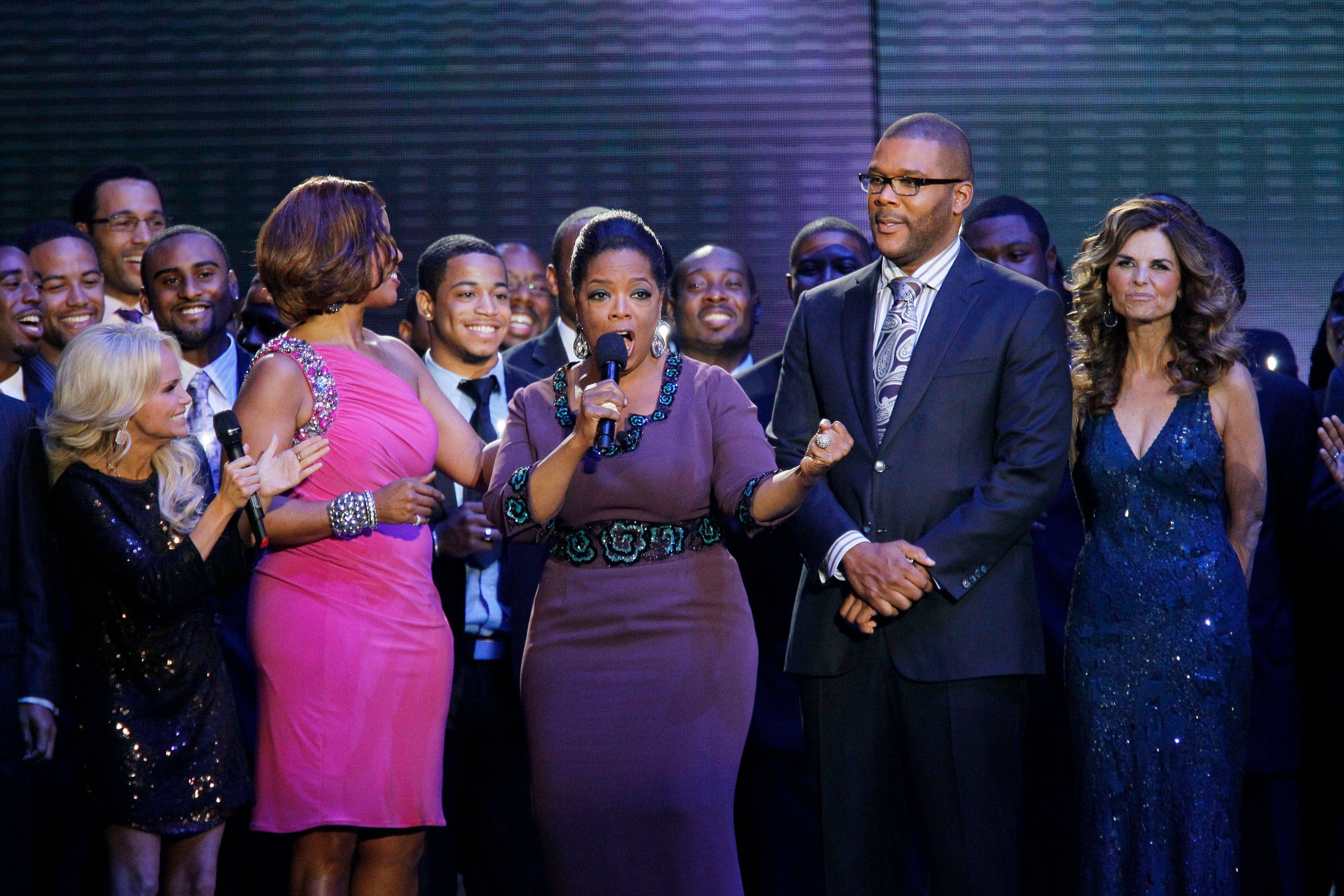 "Oprah Winfrey talks as she is surrounded by Kristin Chenoweth, left, Gayle King, Tyler Perry and Maria Shriver, right, during a star-studded double-taping of ""Surprise Oprah! A Farewell Spectacular,"" Tuesday, May 17, 2011, in Chicago. ""The Oprah Winfrey Show"" is ending its run May 25, after 25 years, and millions of her fans around the globe are waiting to see how she will close out a show that spawned a media empire."