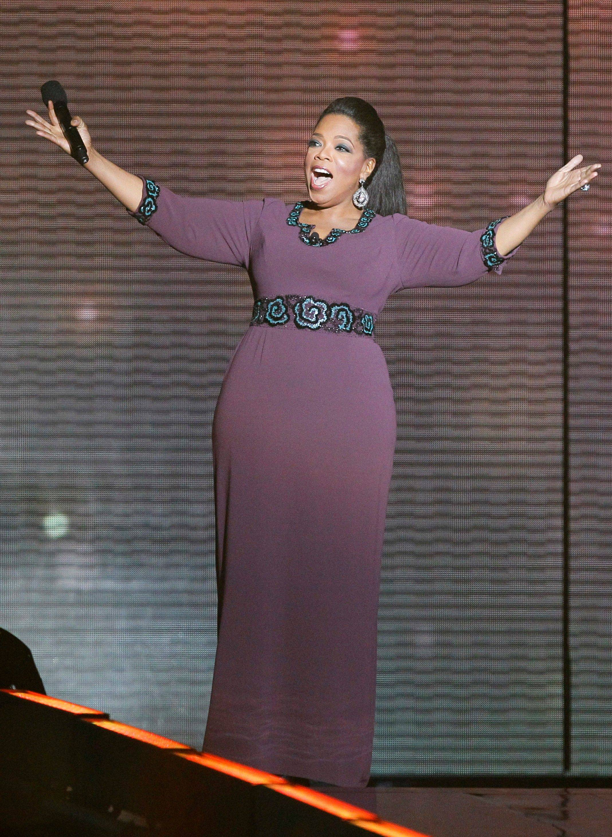 "Oprah Winfrey acknowledges fans Tuesday in Chicago. ""The Oprah Winfrey Show"" is ending its run May 25, after 25 years."