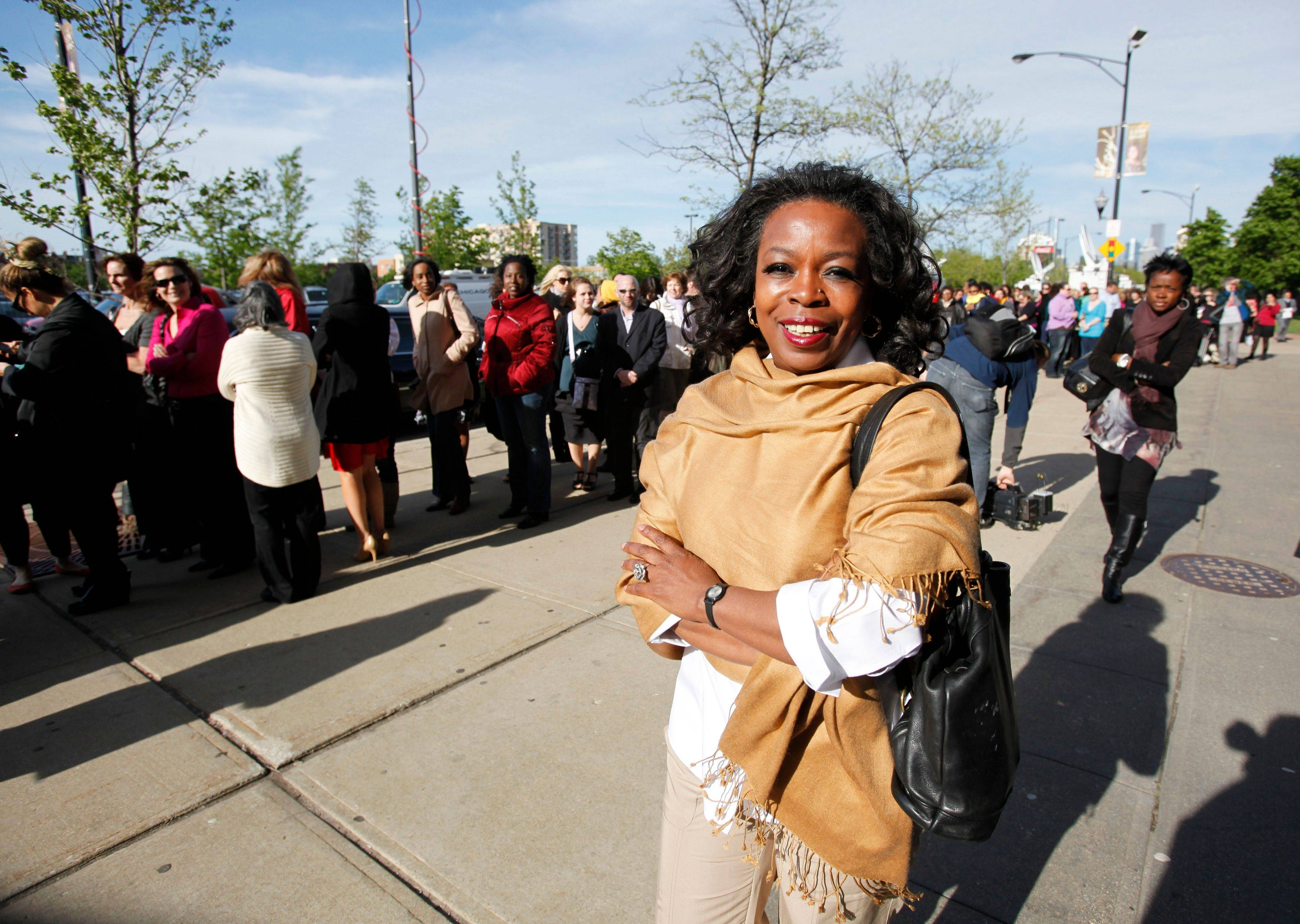 "Caroline Hodge, an Oprah Winfrey look-alike, looks for a ticket to the ""The Oprah Winfrey Show,"" Tuesday outside of the United Center in Chicago.."
