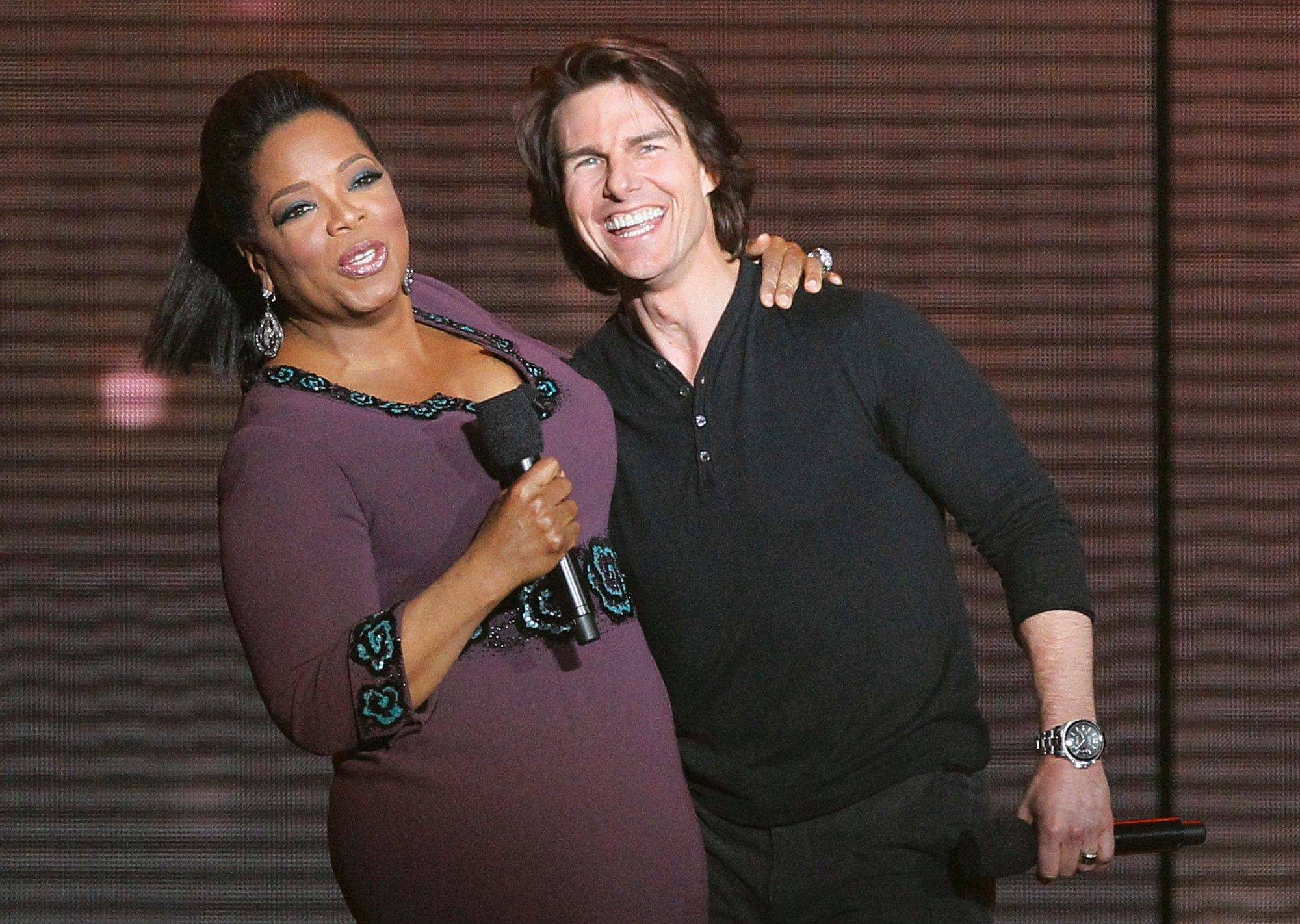 Tom Cruise appears with Oprah Winfrey Tuesday during the final taping of her show.