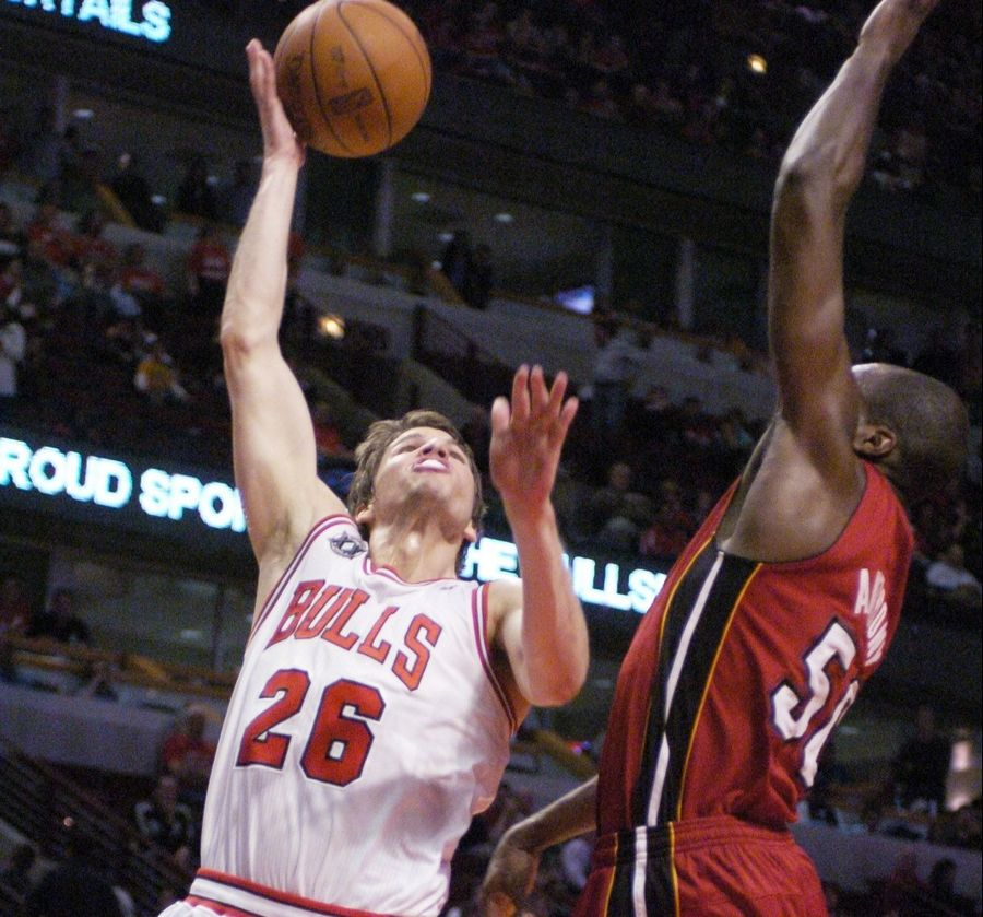 The Bulls' Kyle Korver misses a layup as the Heat's Anthony defends Wednesday.Korver was hardly alone, as the Bulls shot just 34 percent from the field in their 85-75 loss to the Heat in Game 2 of the Eastern Conference finals at the United Center.