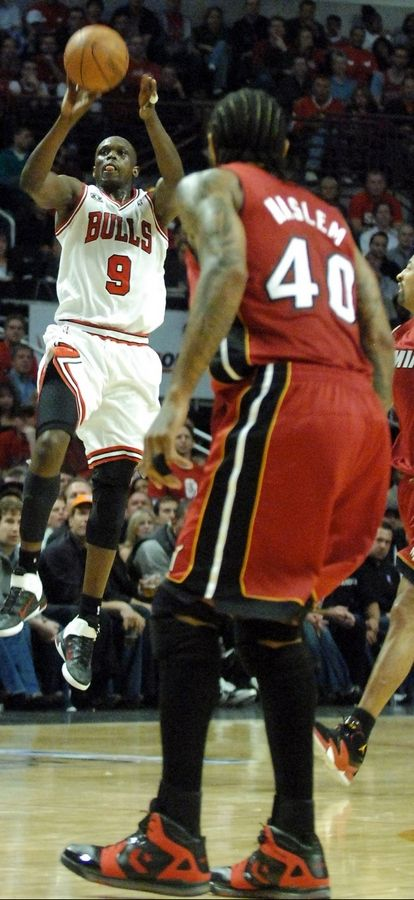 The Bulls' Luol Deng launches a 60-foot basket to end the first quarter Wednesday.
