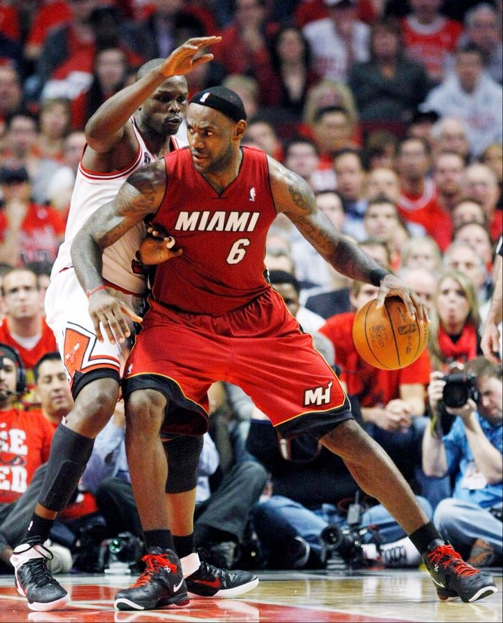 Miami Heat small forward LeBron James (6) drives the ball against Chicago Bulls small forward Luol Deng during the second quarter of Game 2 of the NBA basketball Eastern Conference finals on Wednesday in Chicago.