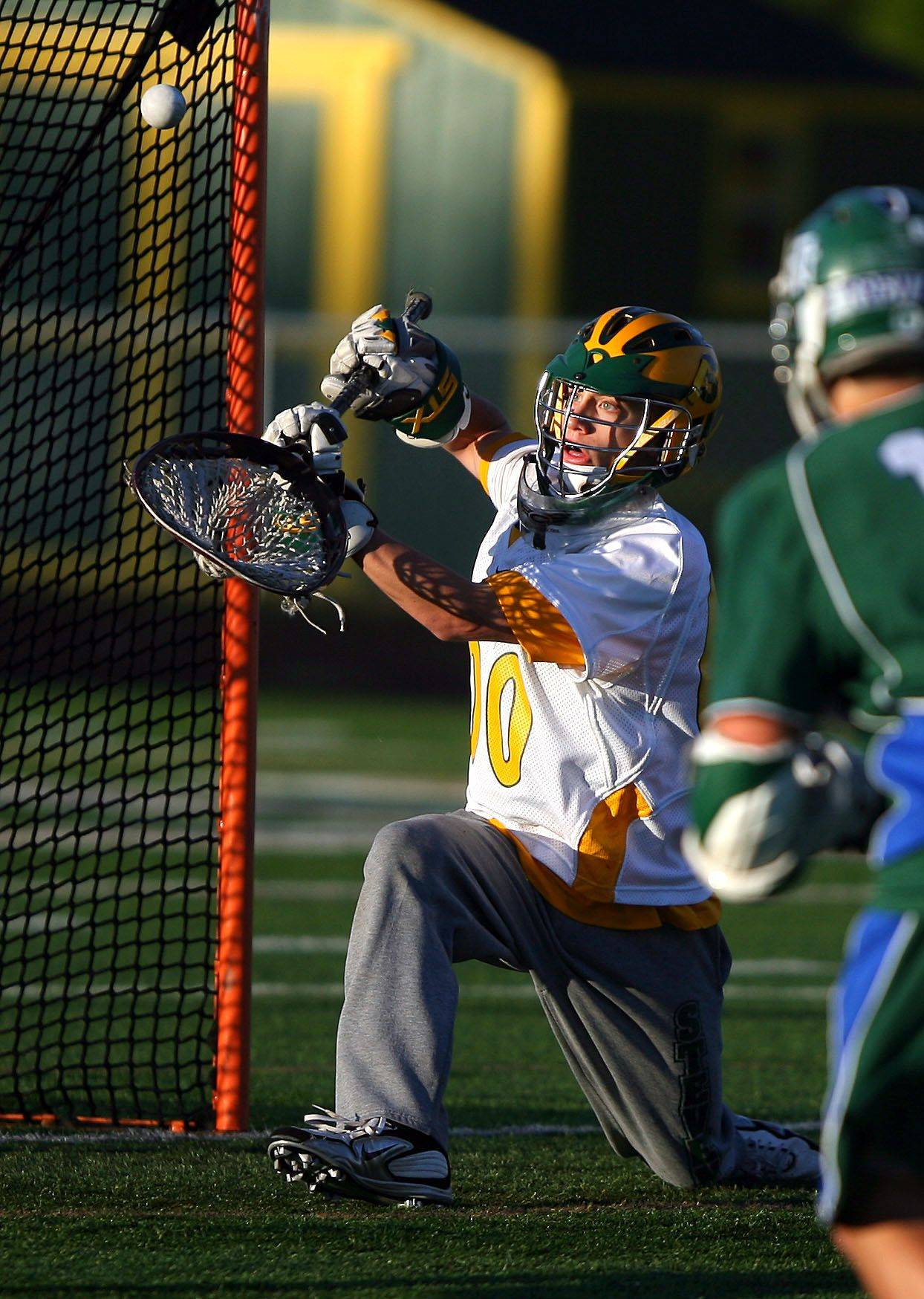 Stevenson's Max Huber makes a nice save during their game against New Trier Tuesday night in Lincolnshire.