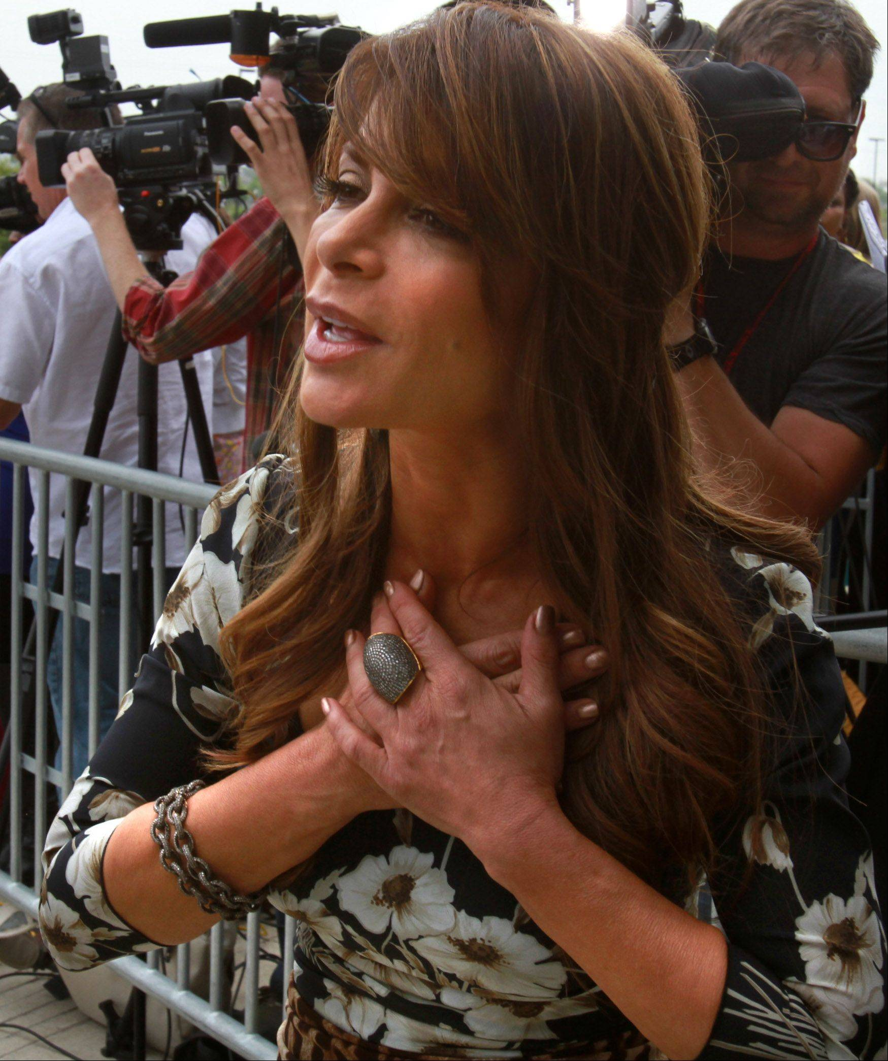 Paula Abdul holds her heart to fans as she arrives at the Sears Centre for taping of the judges round for The X Factor in Hoffman Estates on Thursday, May 19th.