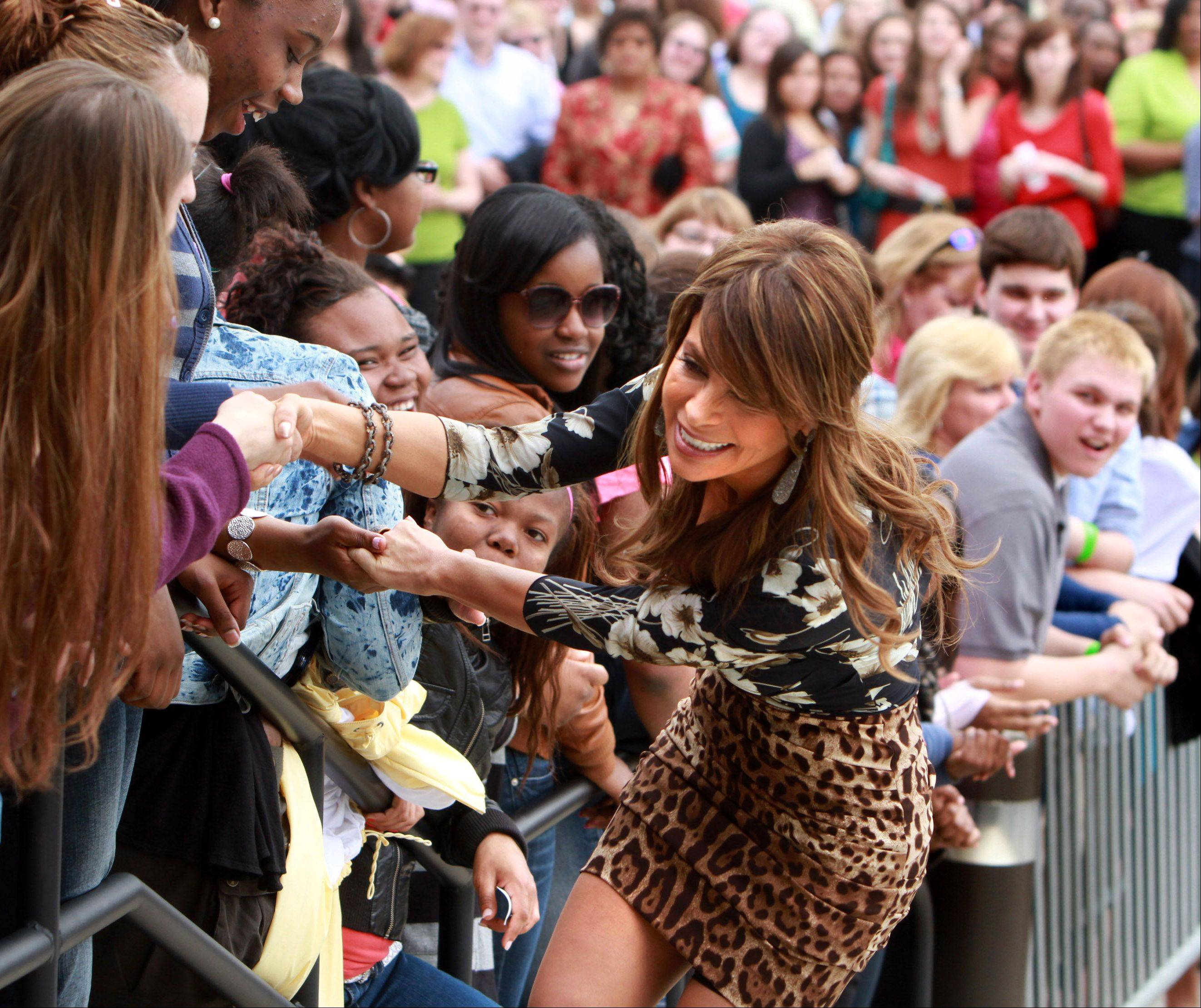 Paula Abdul tries to pull away from clutching fans while coming up the steps to the Sears Centre for the taping of the judges round for The X Factor in Hoffman Estates on Thursday, May 19th.
