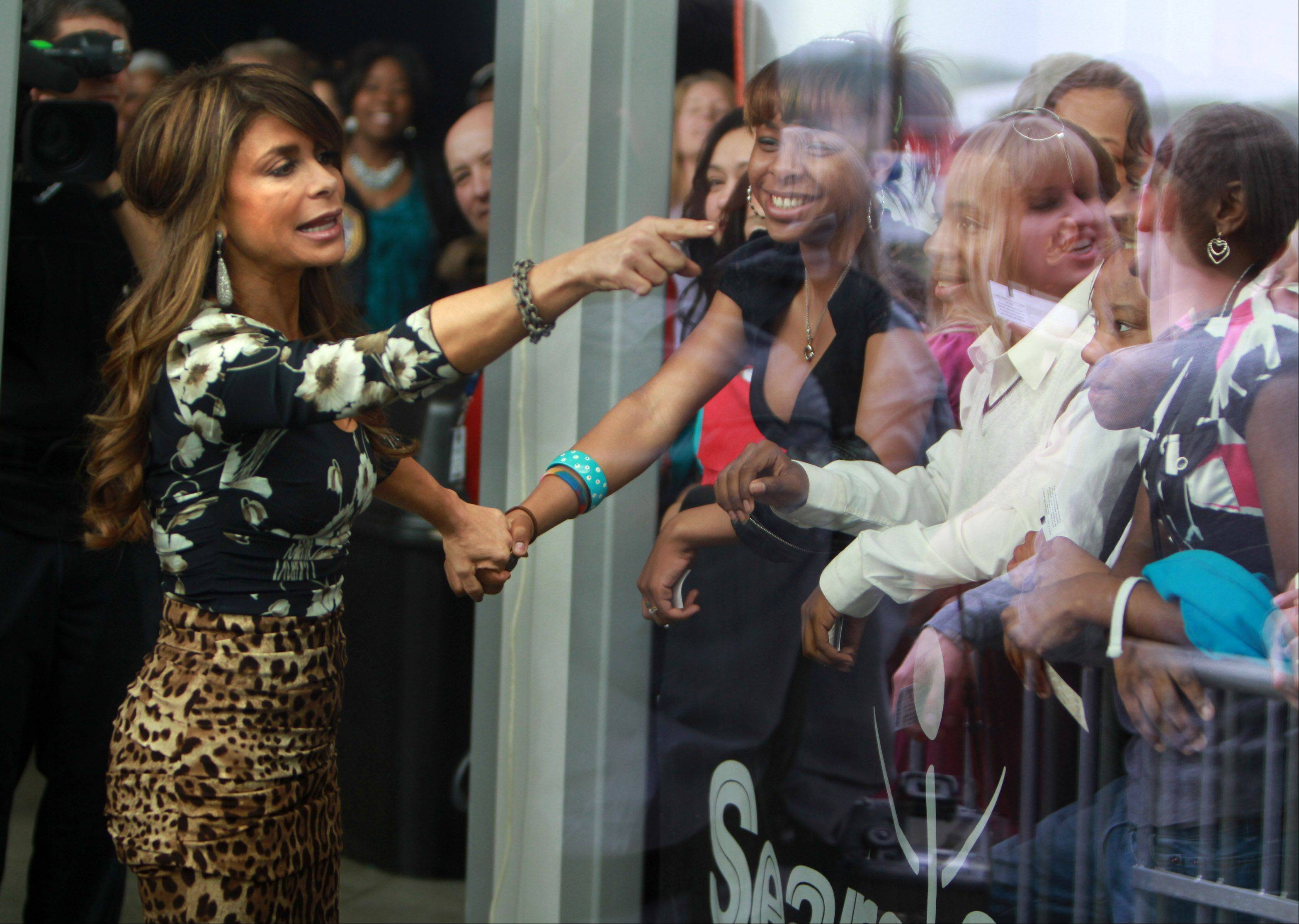 Paula Abdul is photographed through glass as she greets fans inside Sears Centre in Hoffman Estates on Thursday, May 19th.
