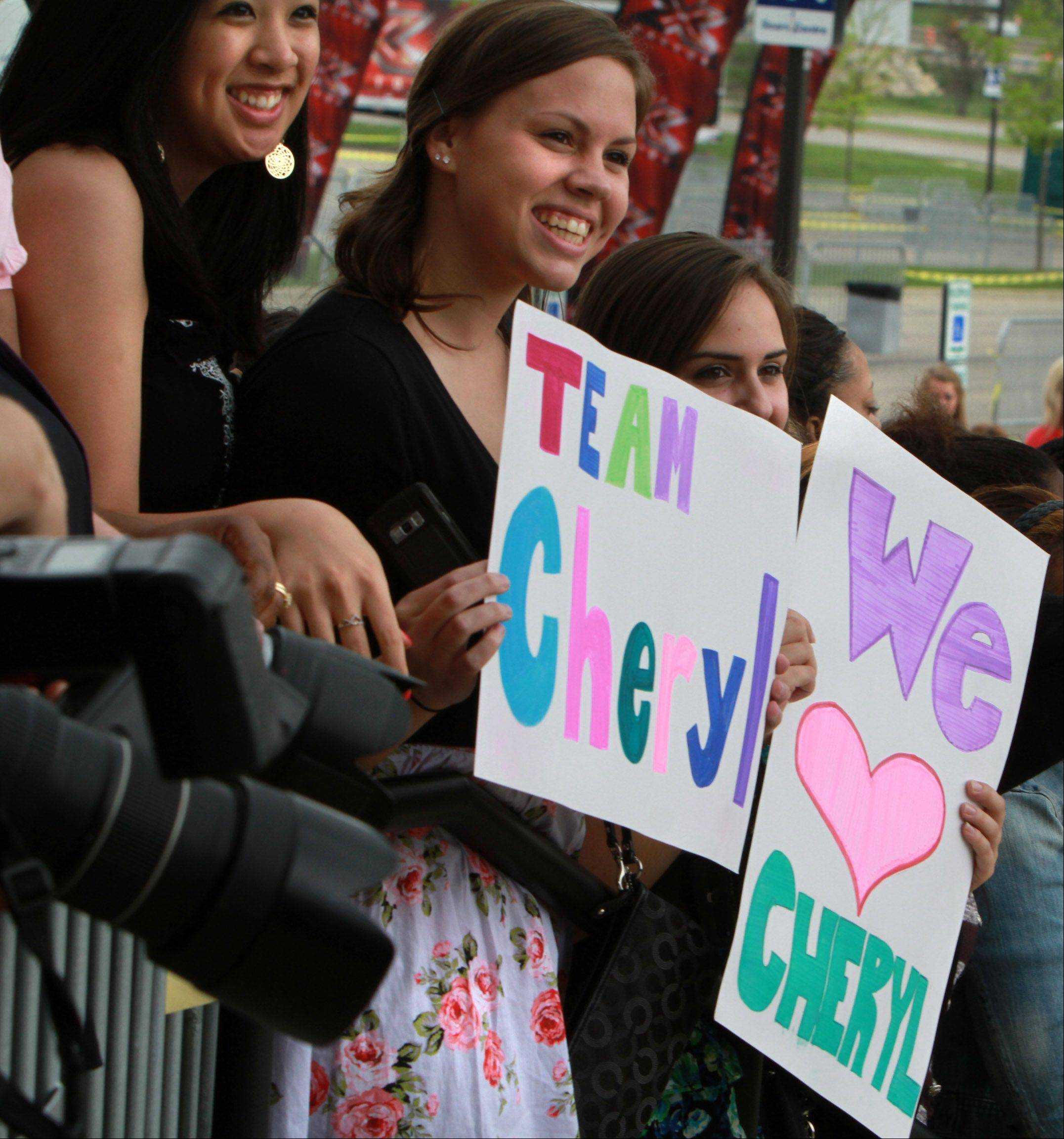Cheryl Cole fans hold signs before the taping of The X Factor at the Sears Centre in Hoffman Estates on Thursday, May 19th.