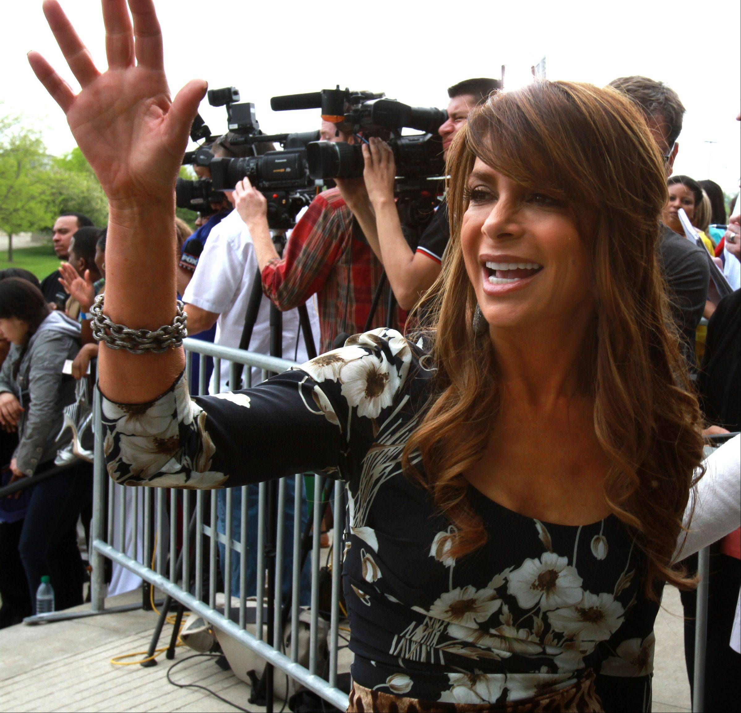 Paula Abdul waves to fans as she arrives at the Sears Centre for taping of the judges round for The X Factor in Hoffman Estates on Thursday, May 19th.