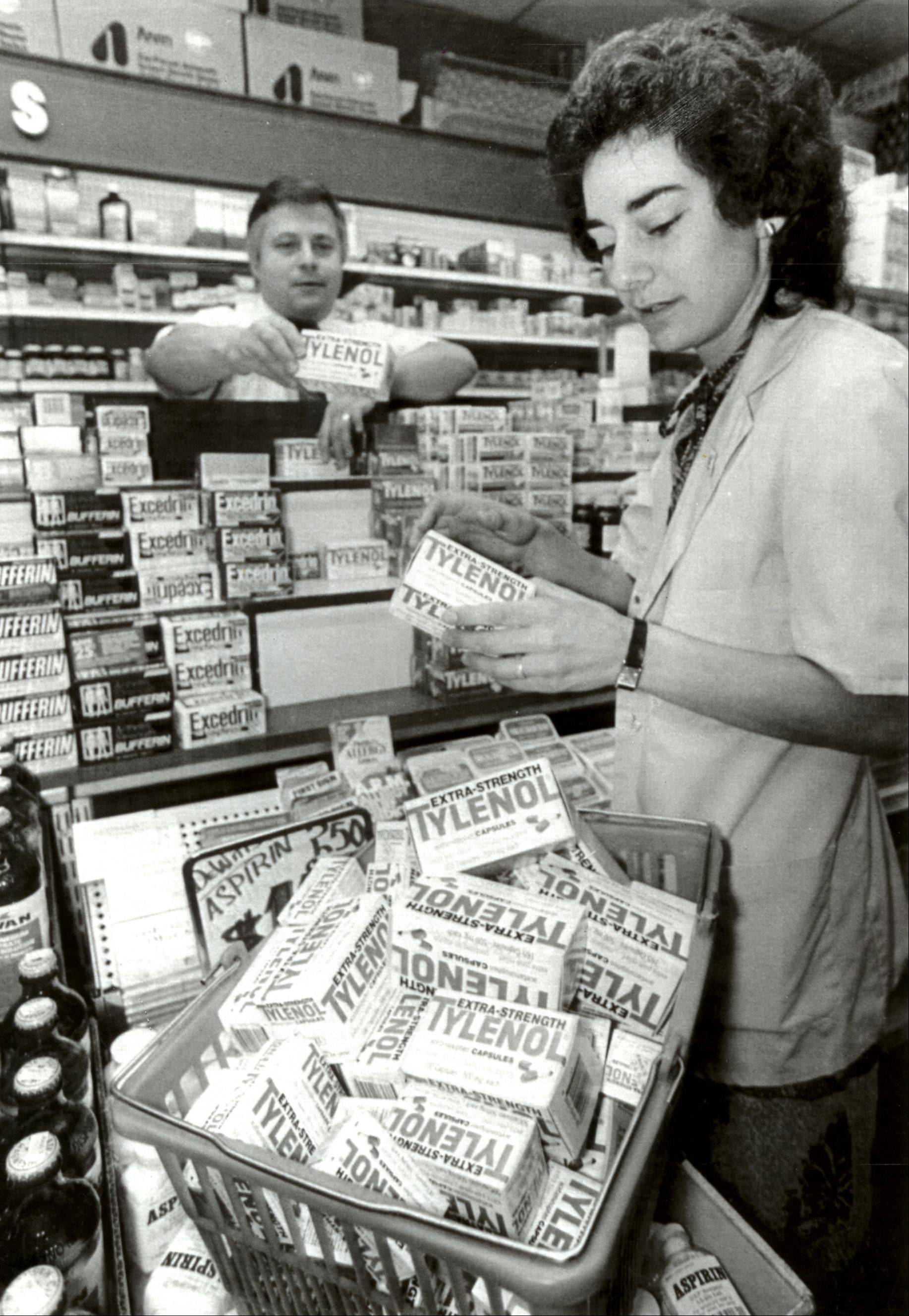 Pharmacist Myrne Spivack and Terry Lehman, manager of Paul's Cut Rate Drugs in Detroit, remove the store's complete stock of Extra-Strength Tylenol capsules from their shelves after the 1982 murders in the Chicago suburbs.