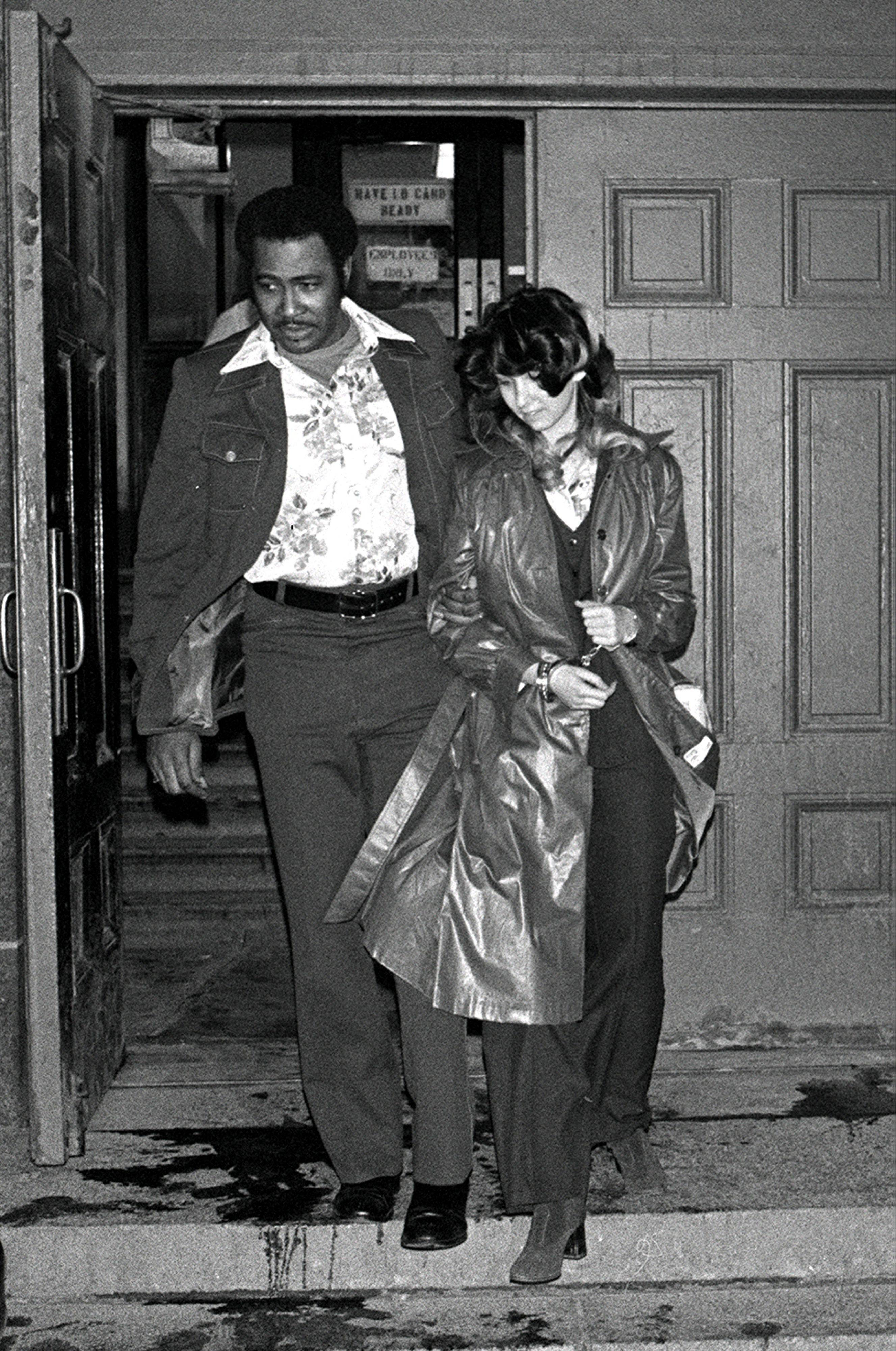 Patty Columbo leavingthe criminal courts building in 1977.