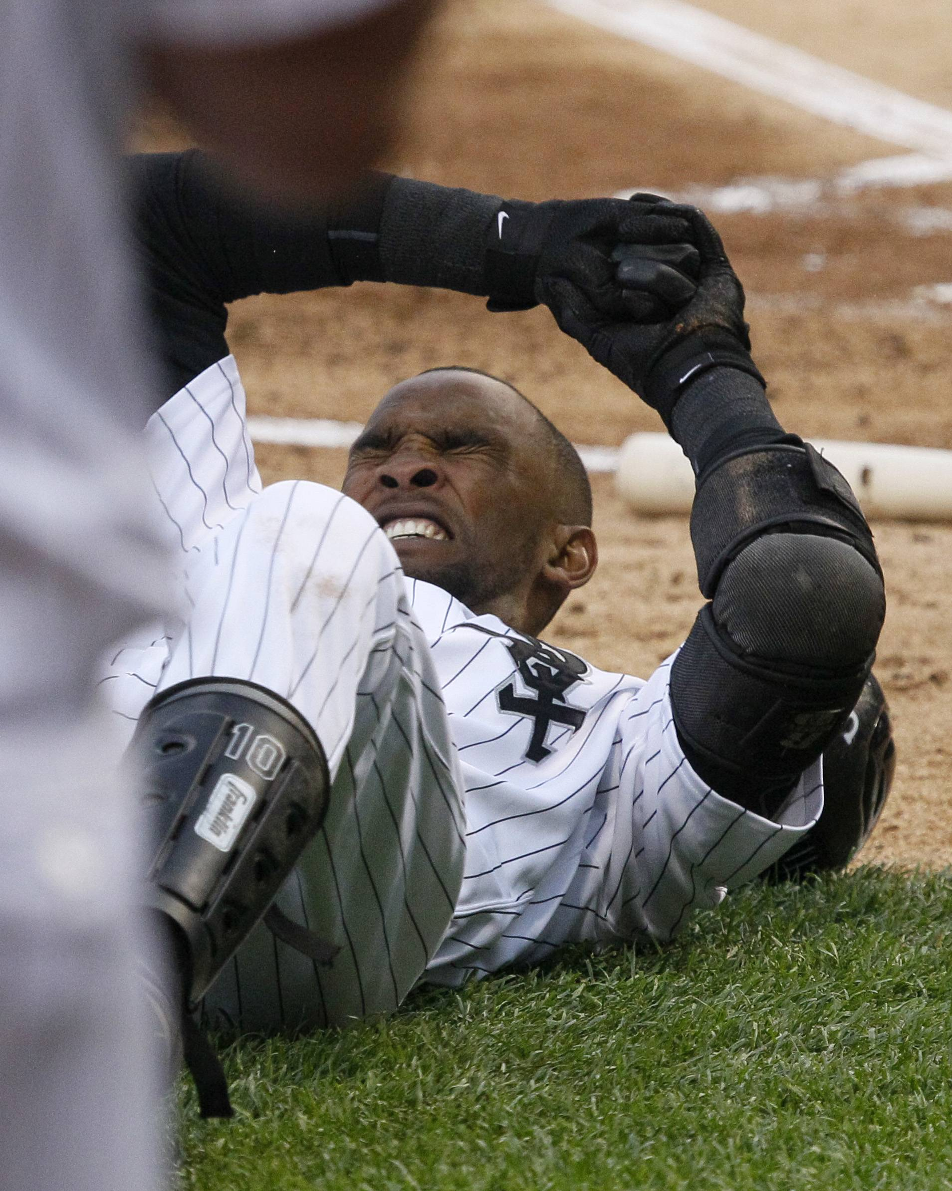 Alexei Ramirez rolls around on the ground after being hit by a pitch from Cleveland Indians starting pitcher Fausto Carmona during the first inning Thursday. Ramirez remained in the game, hitting a two-run double in the second inning.