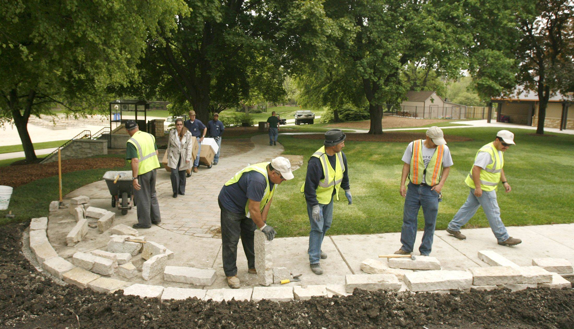 Workers put some final touches on Centennial Beach in Naperville.