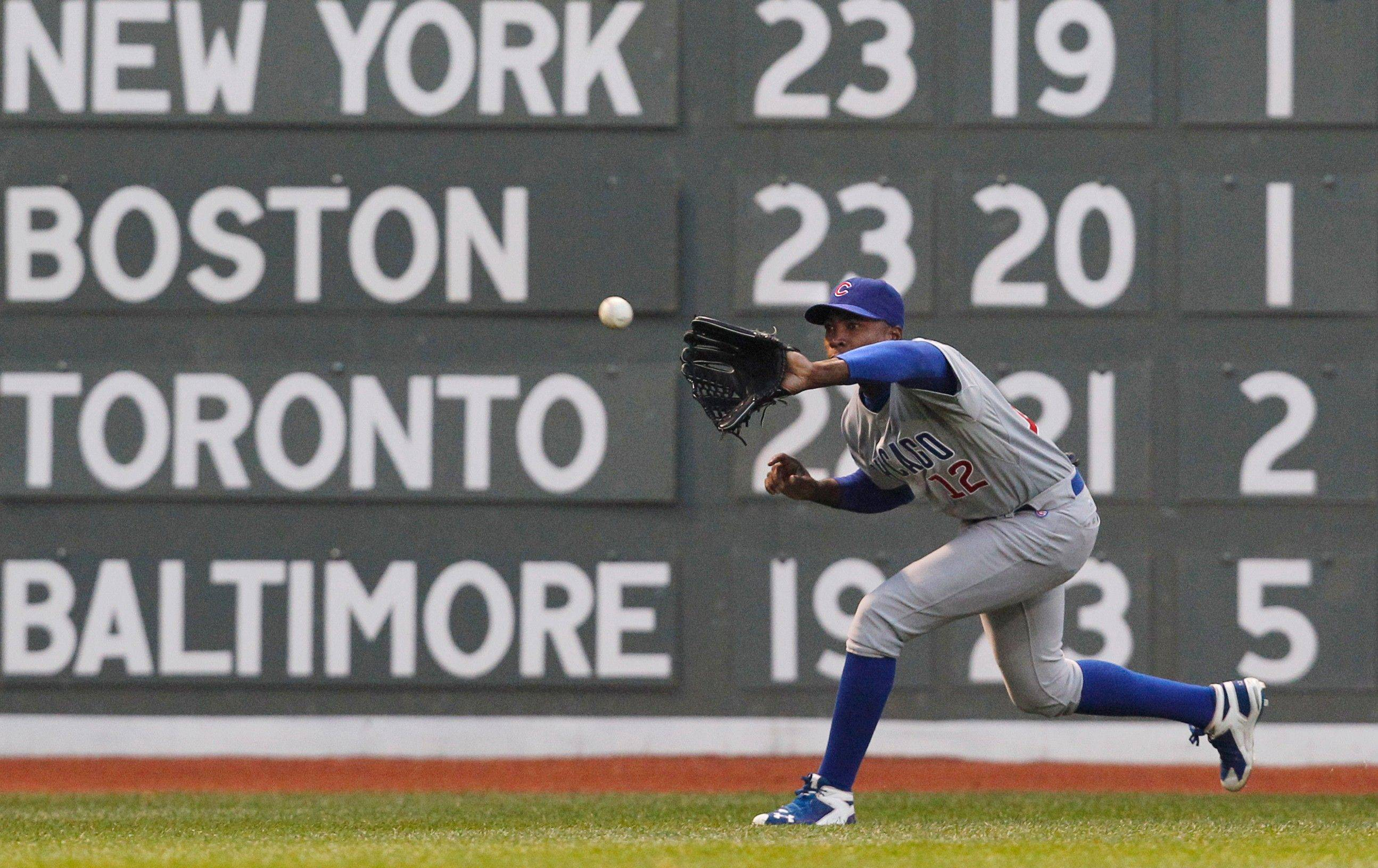 Chicago Cubs left fielder Alfonso Soriano (12) catches a line drive for an out by Boston Red Sox's Jed Lowrie in the first inning of an interleague baseball game at Fenway Park in Boston Friday, May 20, 2011. (AP Photo/Elise Amendola)