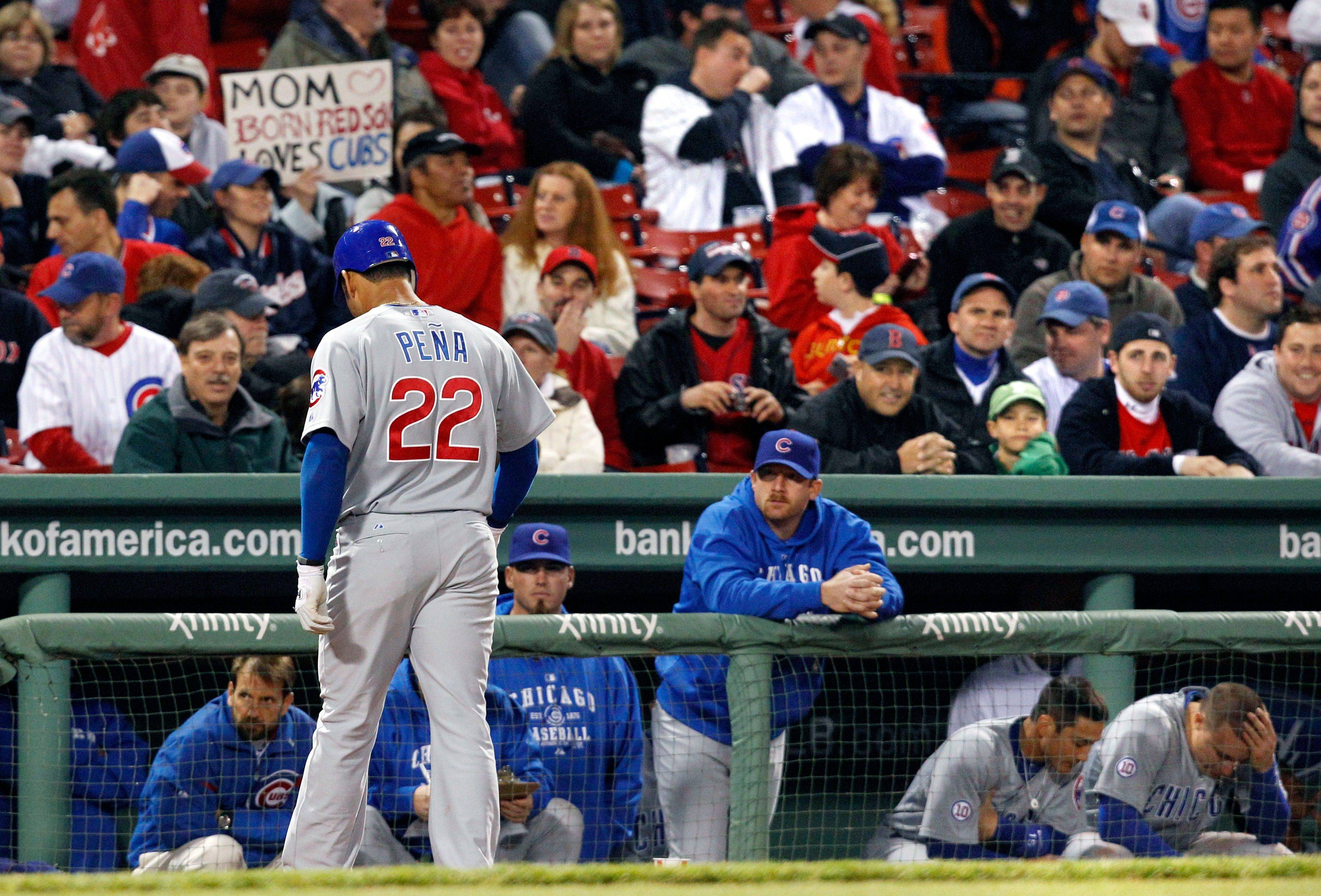 Chicago Cubs' Carlos Pena (22) walks back to the dugout after grounding out against the Boston Red Sox in the ninth inning of an interleague baseball game at Fenway Park in Boston Friday, May 20, 2011. The Red Sox won 15-5.