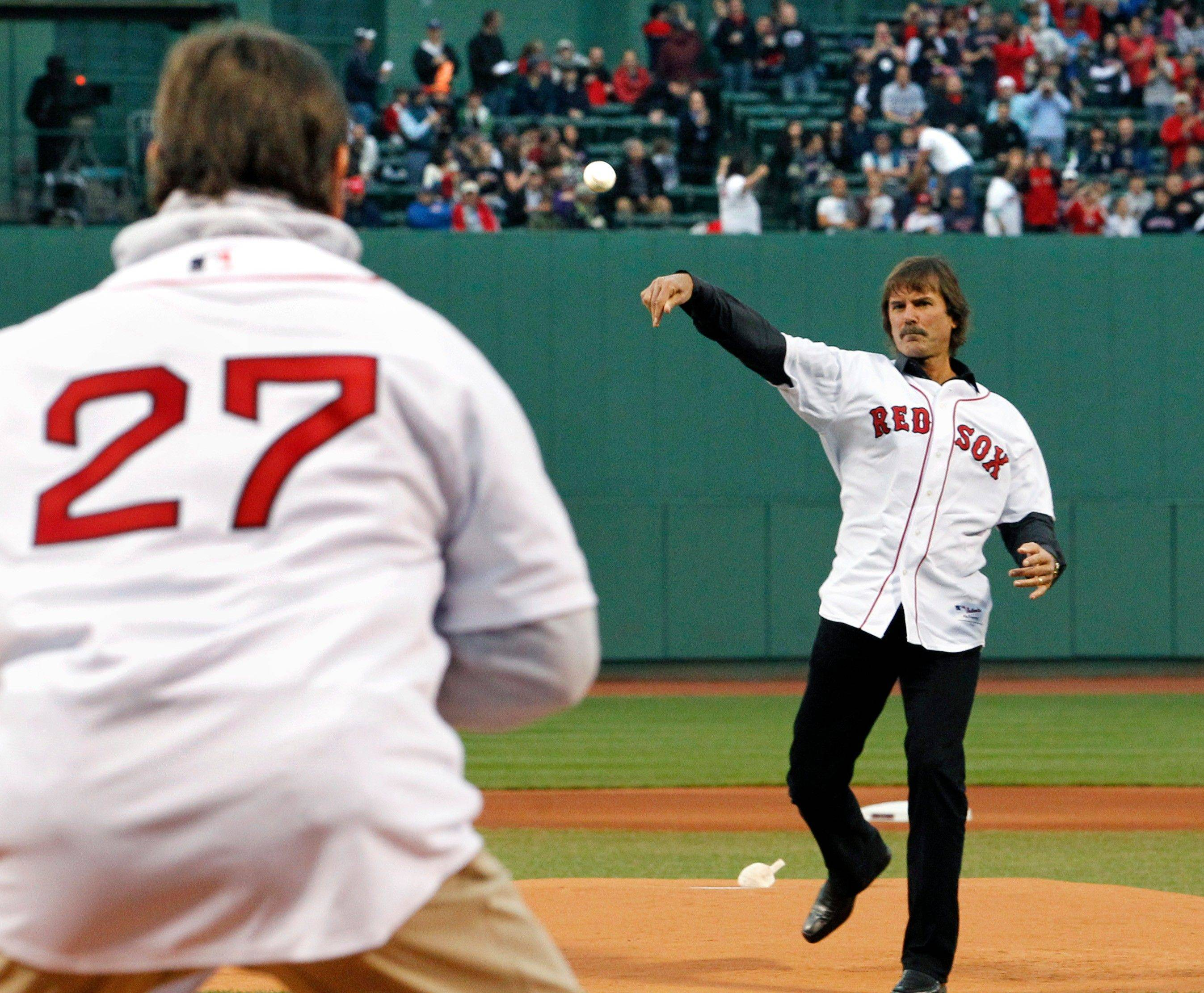 Boston Red Sox legend, pitcher Dennis Eckersley, right, and catcher Carlton Fisk (27) participate in the honorary first pitch prior to an interleague baseball game against the Chicago Cubs at Fenway Park in Boston Friday, May 20, 2011.