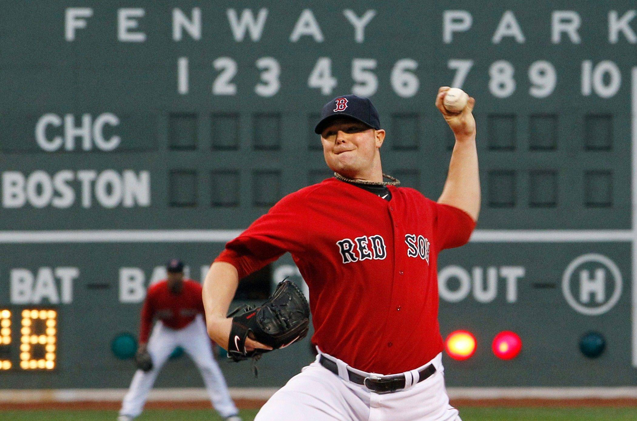 Boston Red Sox starting pitcher Jon Lester delivers to the Chicago Cubs in the first inning of an interleague baseball game at Fenway Park in Boston Friday, May 20, 2011.
