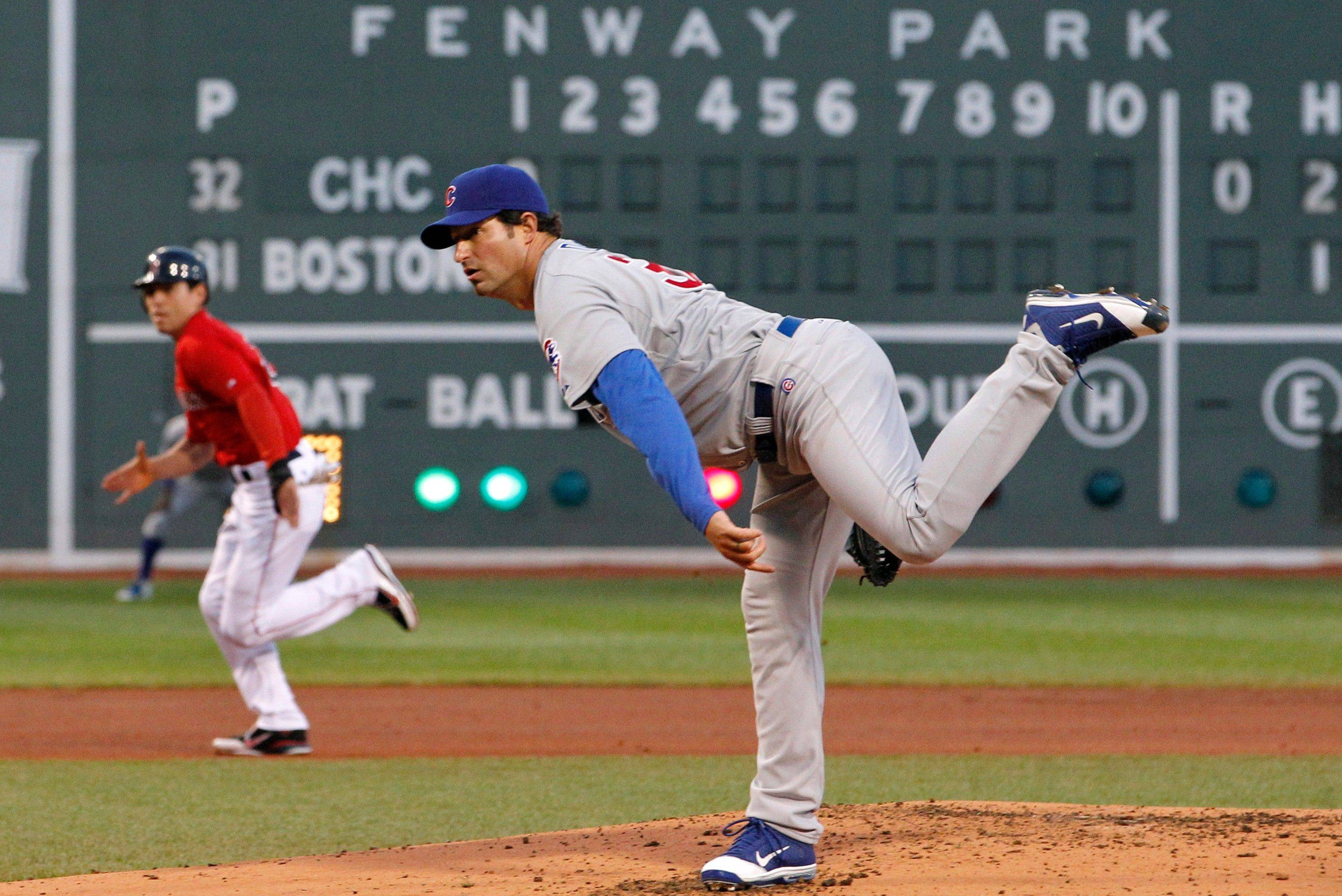 Chicago Cubs starting pitcher Doug Davis delivers as Boston Red Sox's Jacoby Ellsbury runs to steal third base in the first inning of an interleague baseball game at Fenway Park in Boston Friday, May 20, 2011.