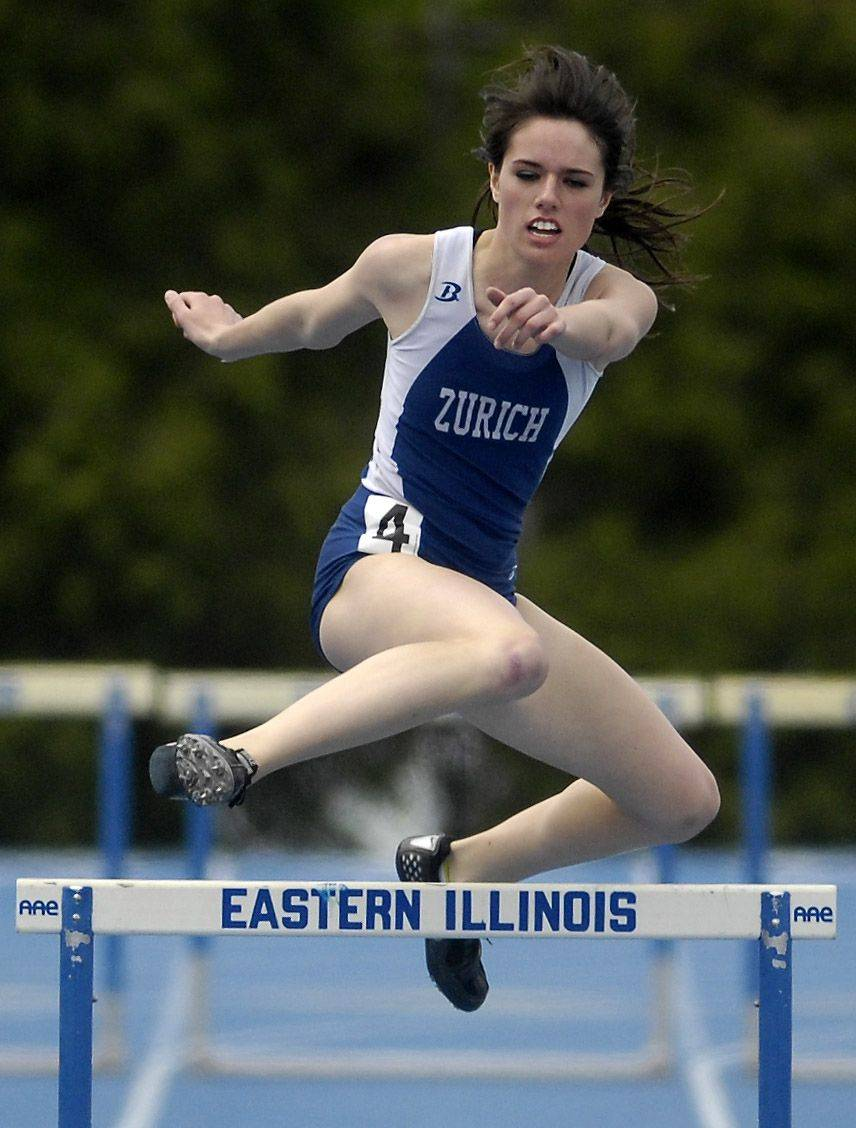 Lake Zurich's Amy Polhemus runs the 300-meter low hurdles Friday.