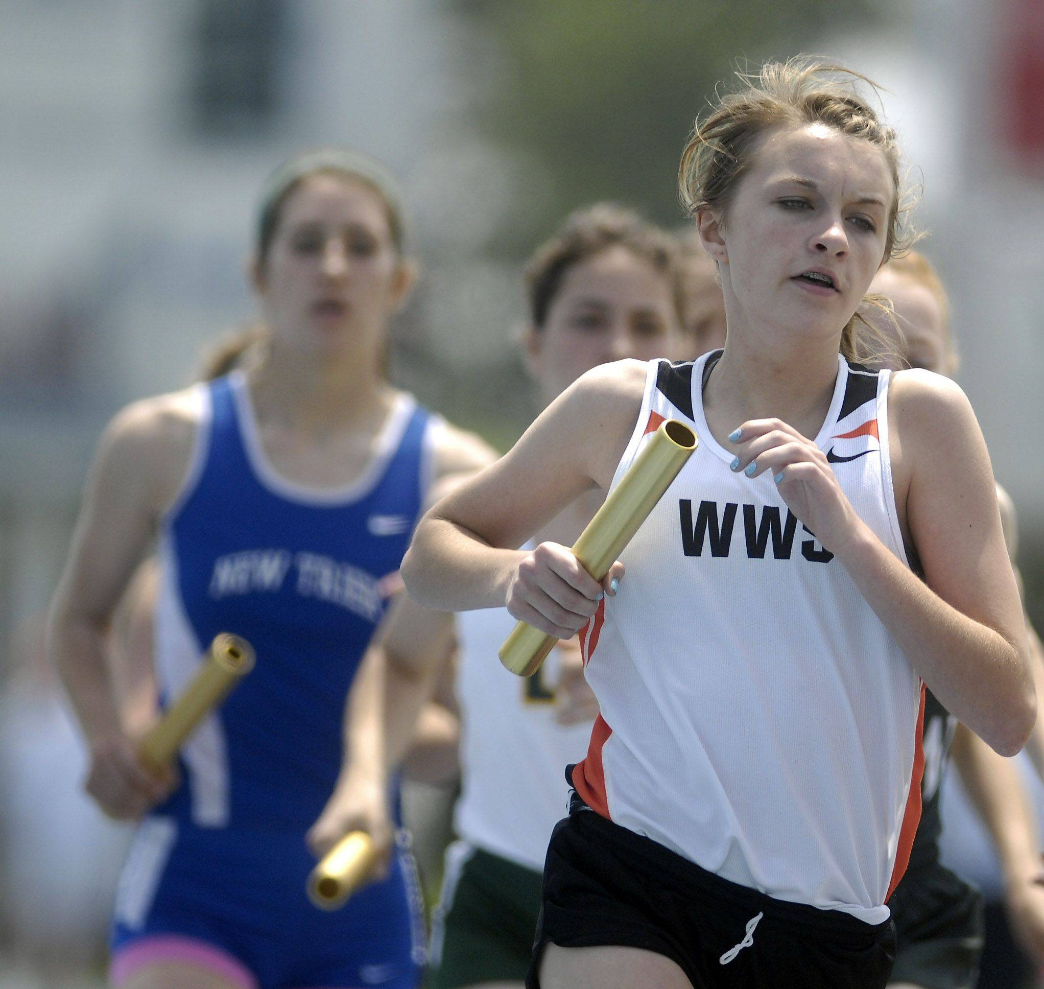 Wheaton Warrenville South's Mikayla Kightlinger runs her leg of the 4x800-meter relay Friday in Charleston.