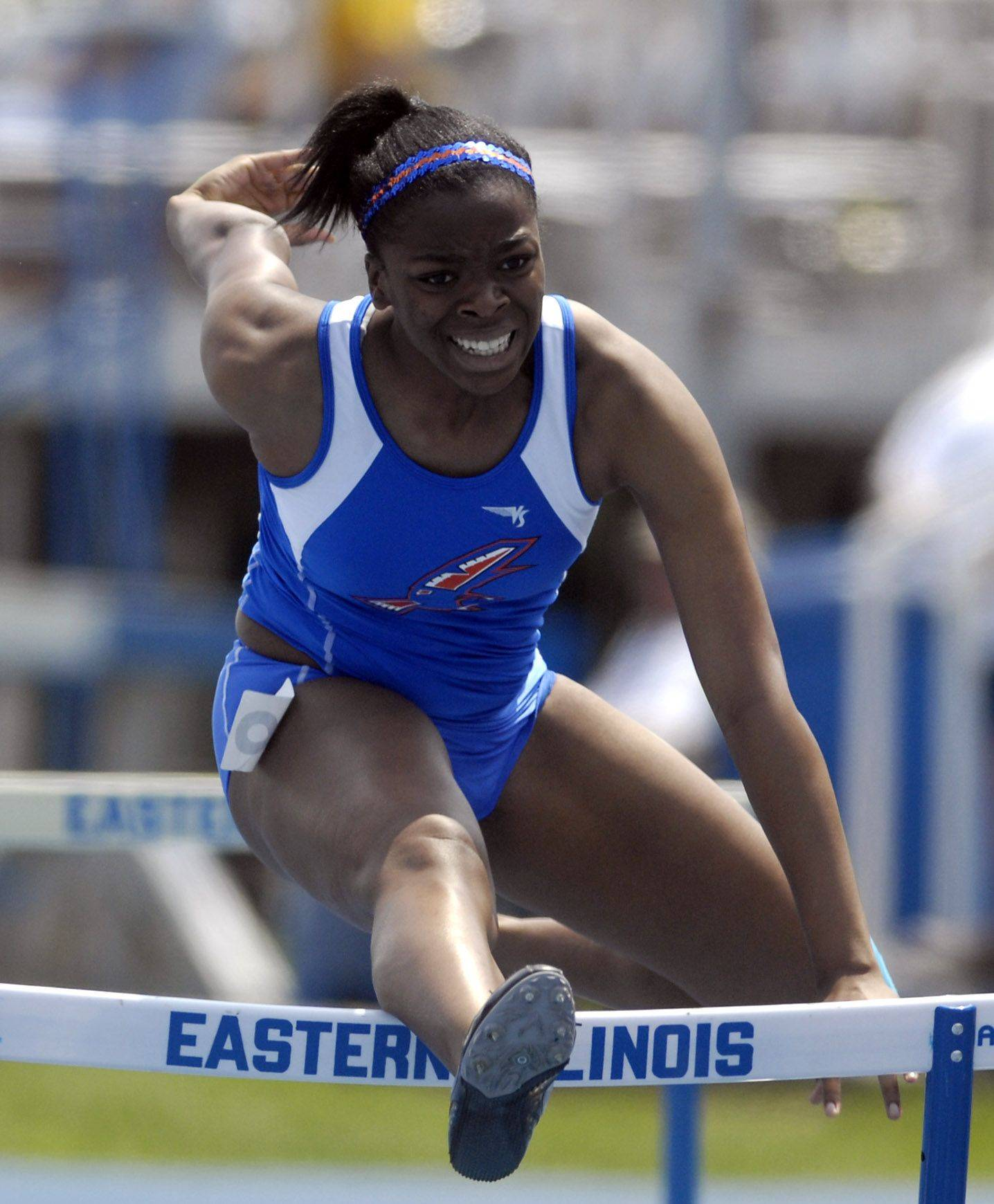 Hoffman Estates High School's Brittany Love hits a hurdle and goes down in the 100-meter high hurdles during Friday's preliminaries of the IHSA girls state track finals in Charleston.
