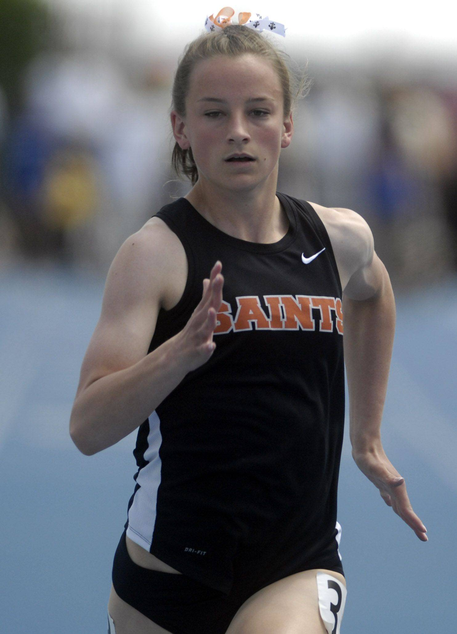 St. Charles East's Kelsey Gentry runs the 100-meter dash Friday in Charleston.