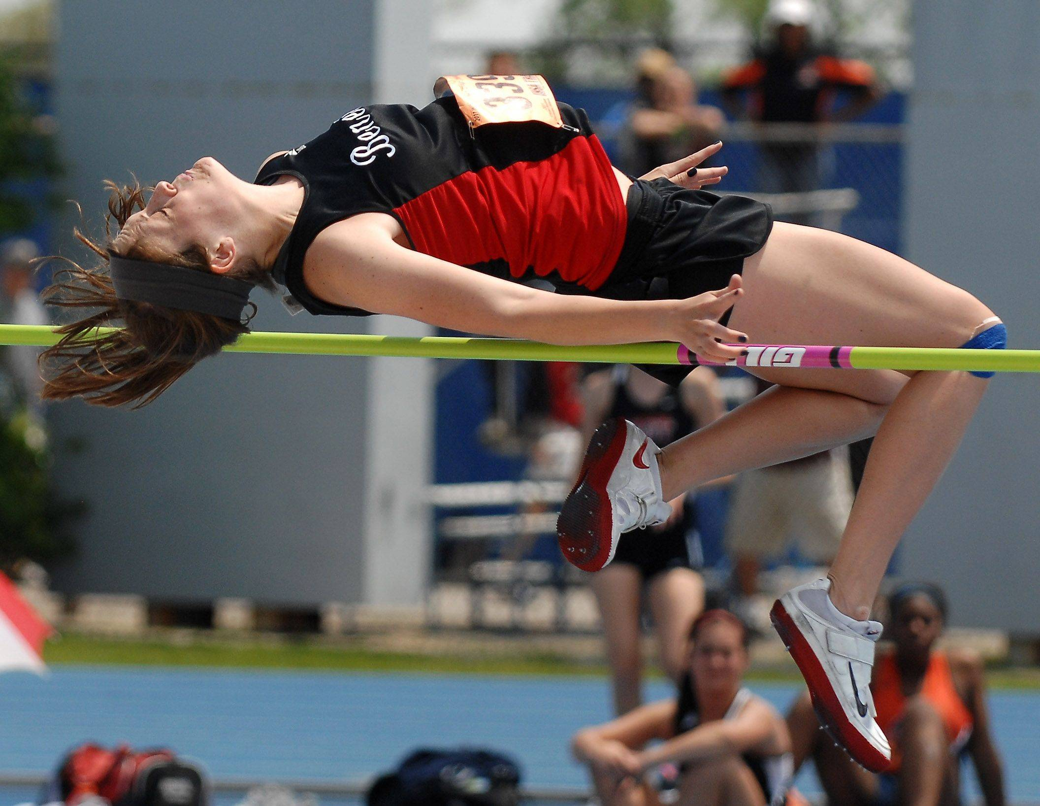 Benet Academy's Darcy Cadman competes in the high jump Friday in Charleston.