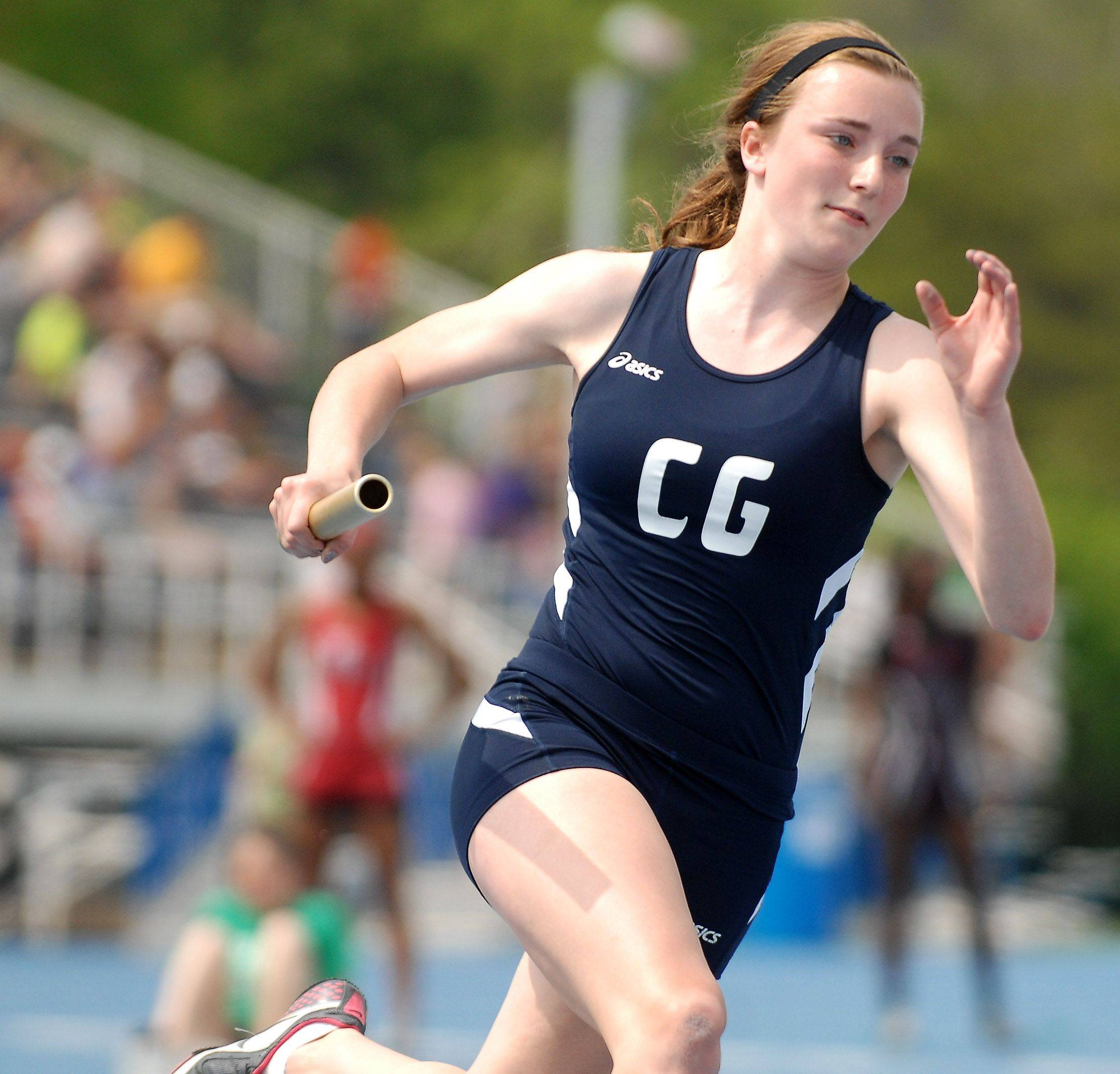 Cary-Grove's Anne McGarrigle runs her leg of the 4x200-meter relay Friday.