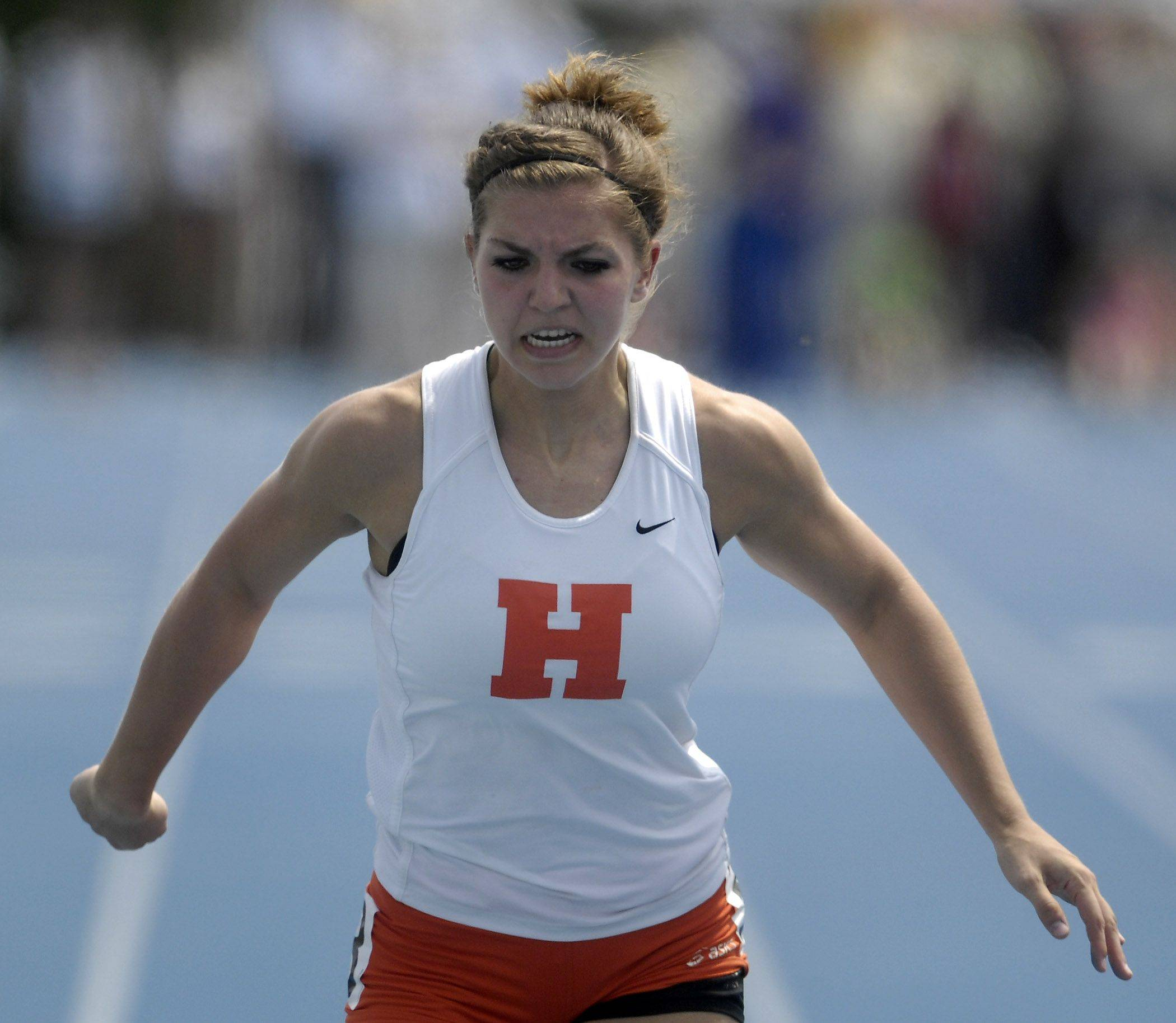 Hersey's Danielle Perkins crosses the finish line in the 100-meter dash Friday.