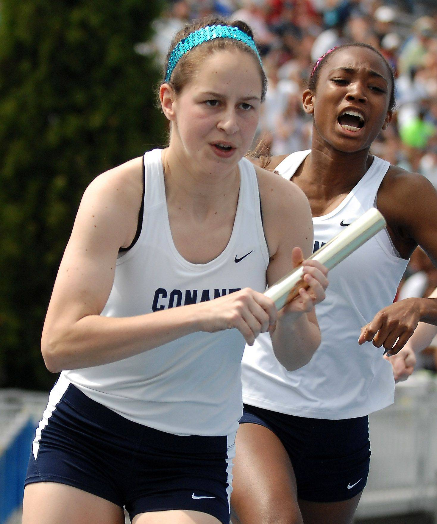 Conant's Tina Tortorici takes the baton from Maya Lane in the 4x200-meter relay in Charleston.