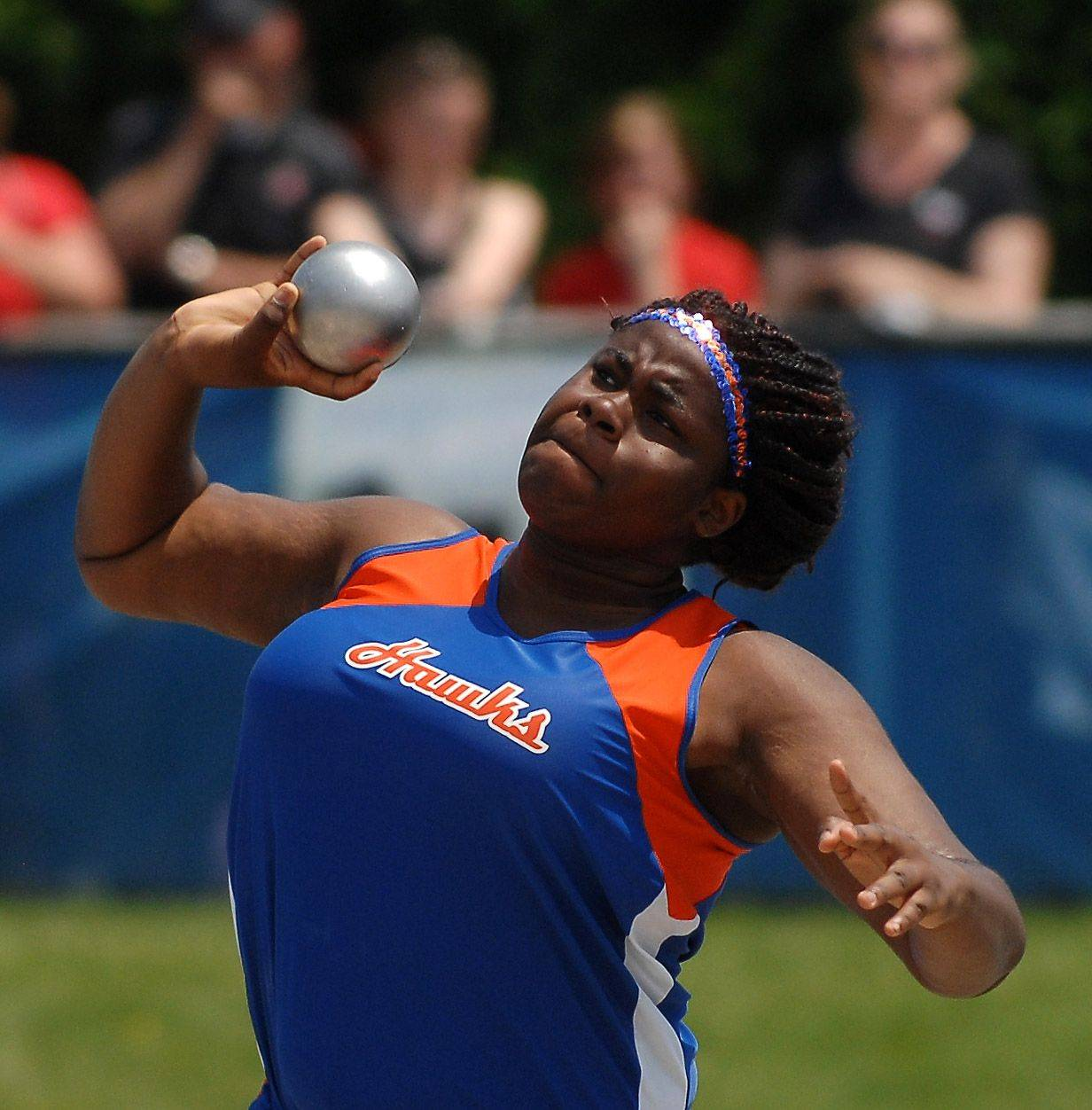 Hoffman Estates High School's Banke Oginni puts the shot during Friday's preliminaries.