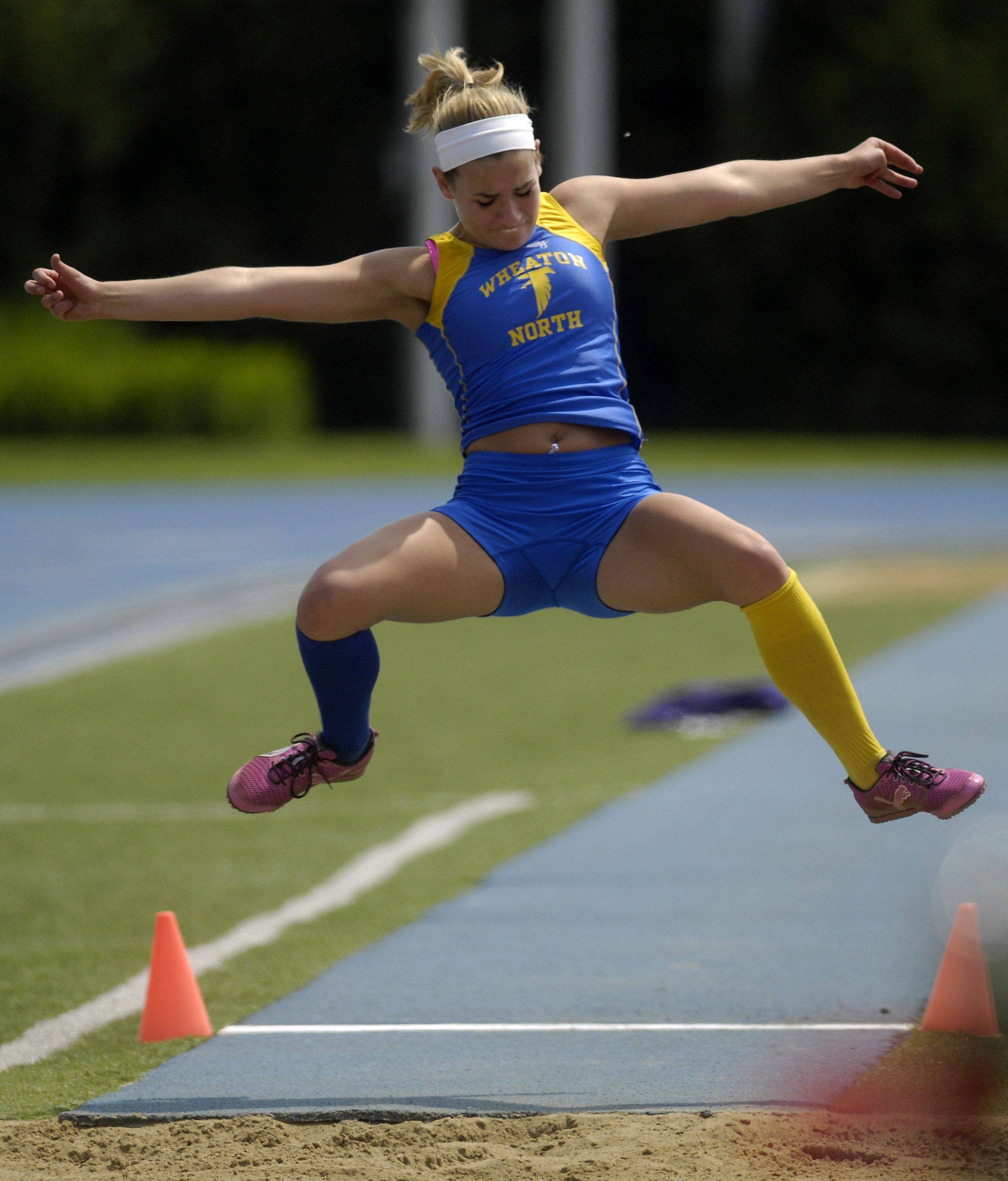 Wheaton North's Kelly O'Connor competes in the long jump during Friday's preliminaries of the IHSA girls state track finals in Charleston.
