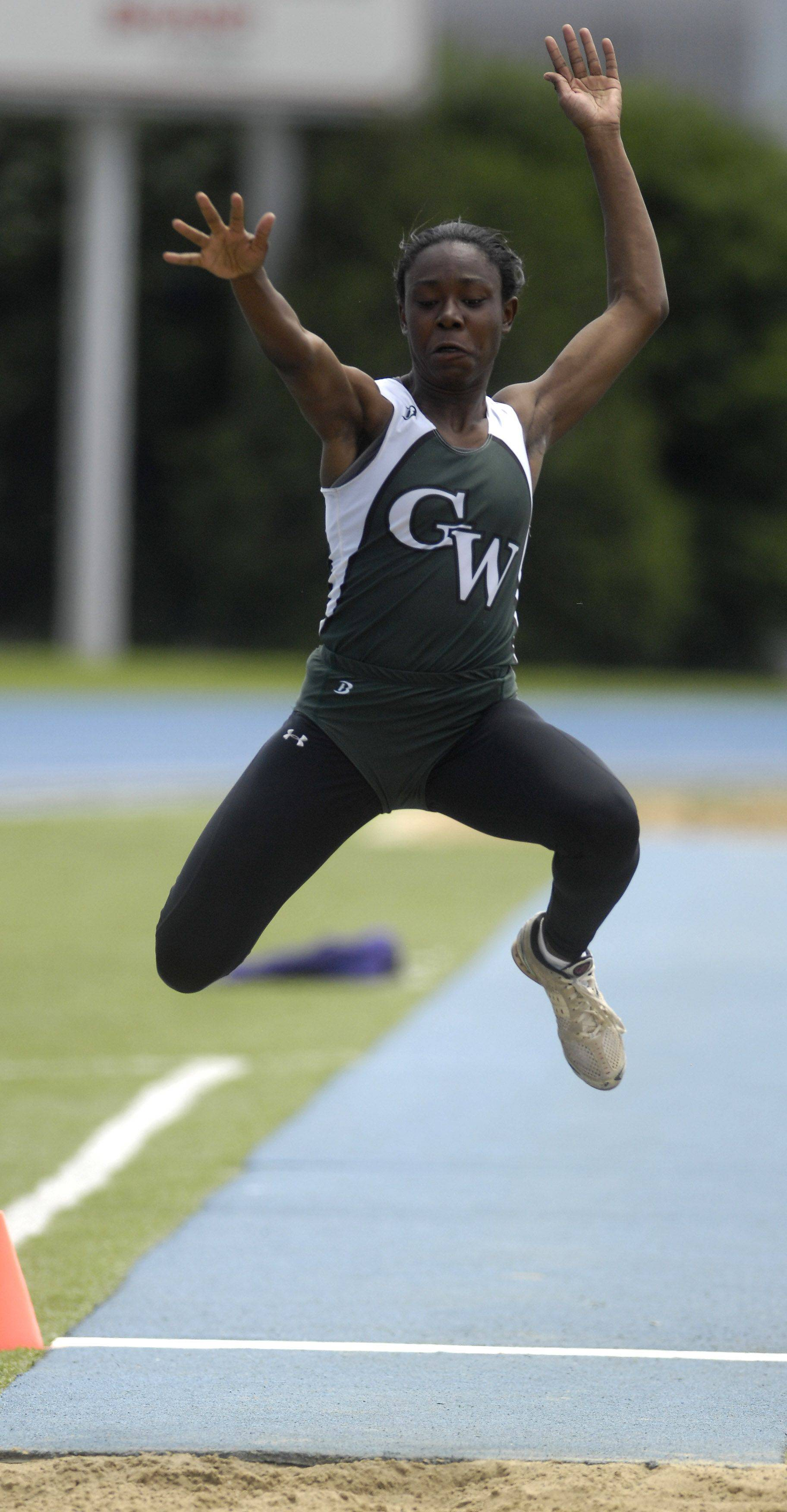 Glenbard West's Kathryn Pickett competes in the long jump during Friday's preliminaries of the IHSA girls state track finals in Charleston.