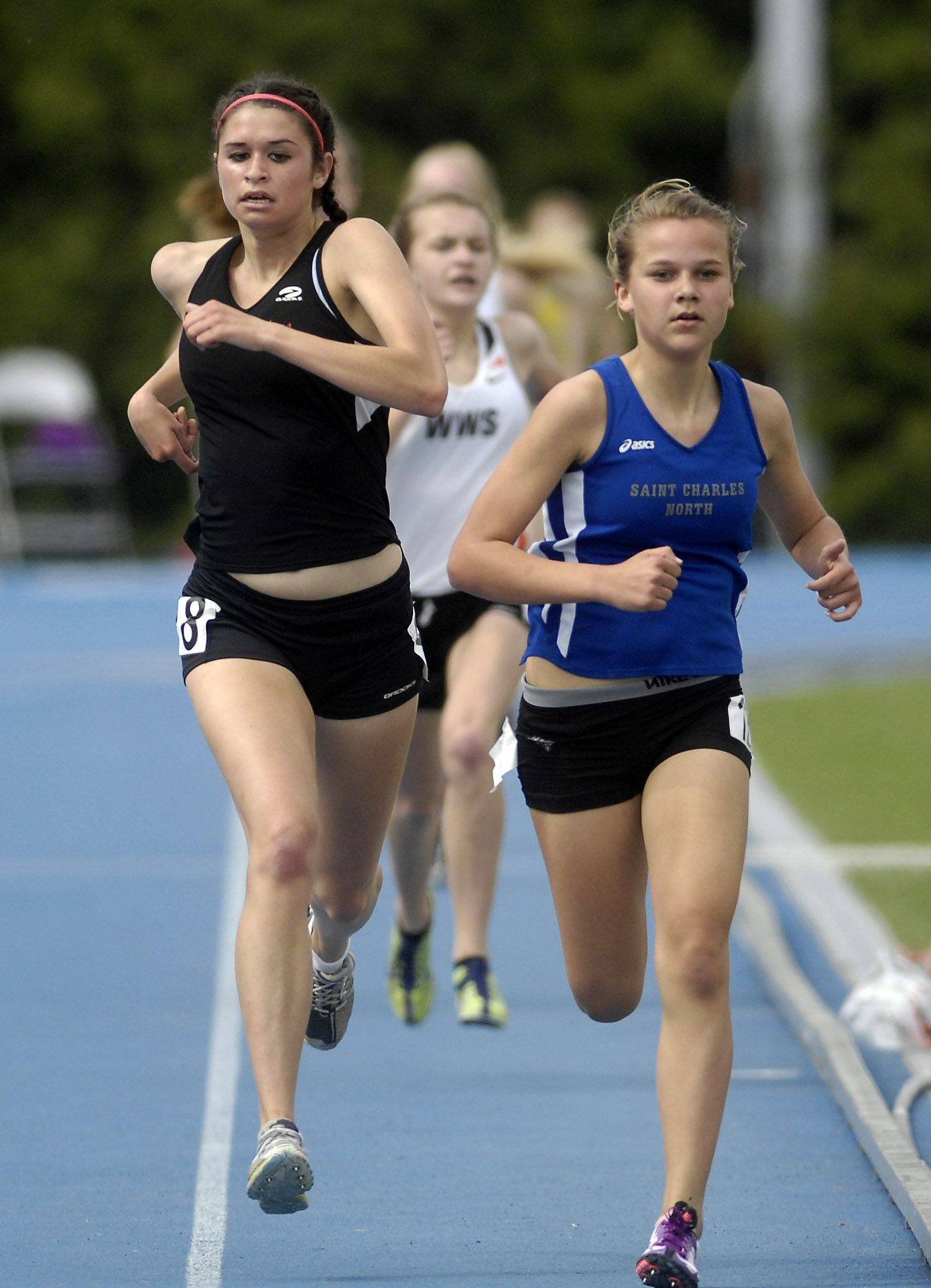 Huntley's Haley Loprieno and St. Charles North's Sydney Stuenkel are shoulder to shoulder down the stretch of the 1600 during Friday's preliminaries of the IHSA girls state track finals.