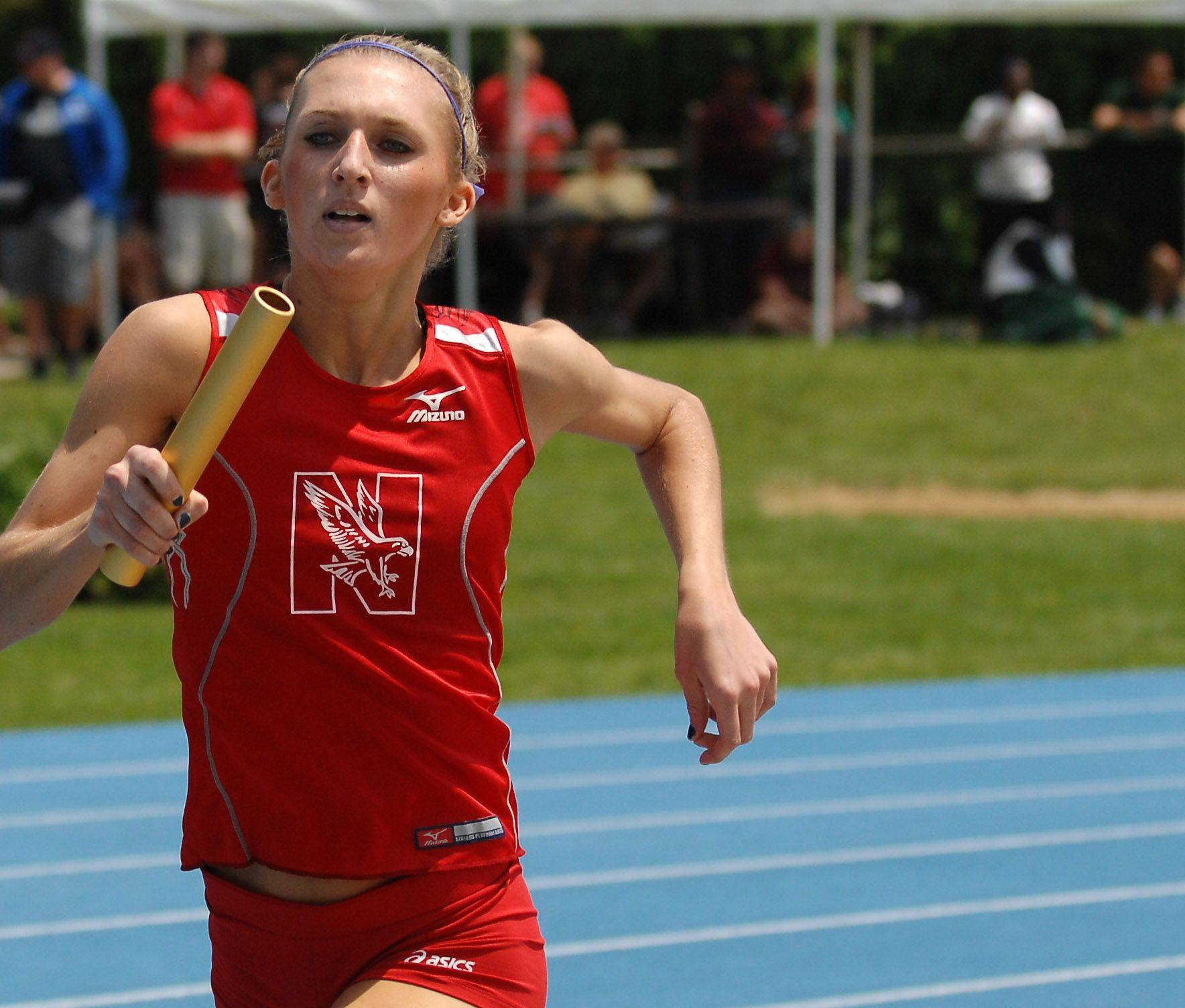 Naperville Central's Kailey Mikulec runs her leg of the 4x800-meter relay.