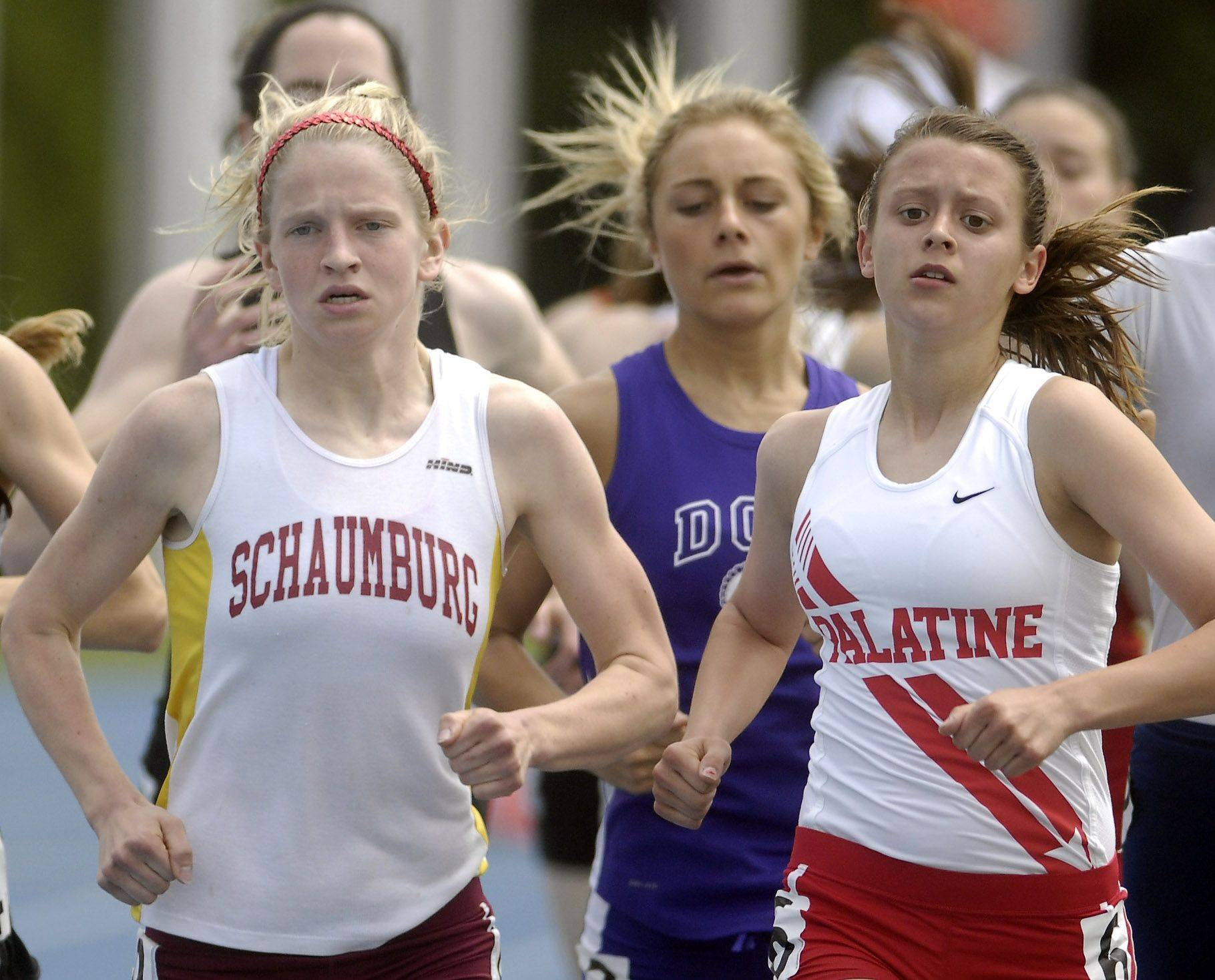 Schaumburg's Britten Petrey and Palatine's Tess Wasowicz during Friday's preliminaries of the IHSA girls state track finals in Charleston.