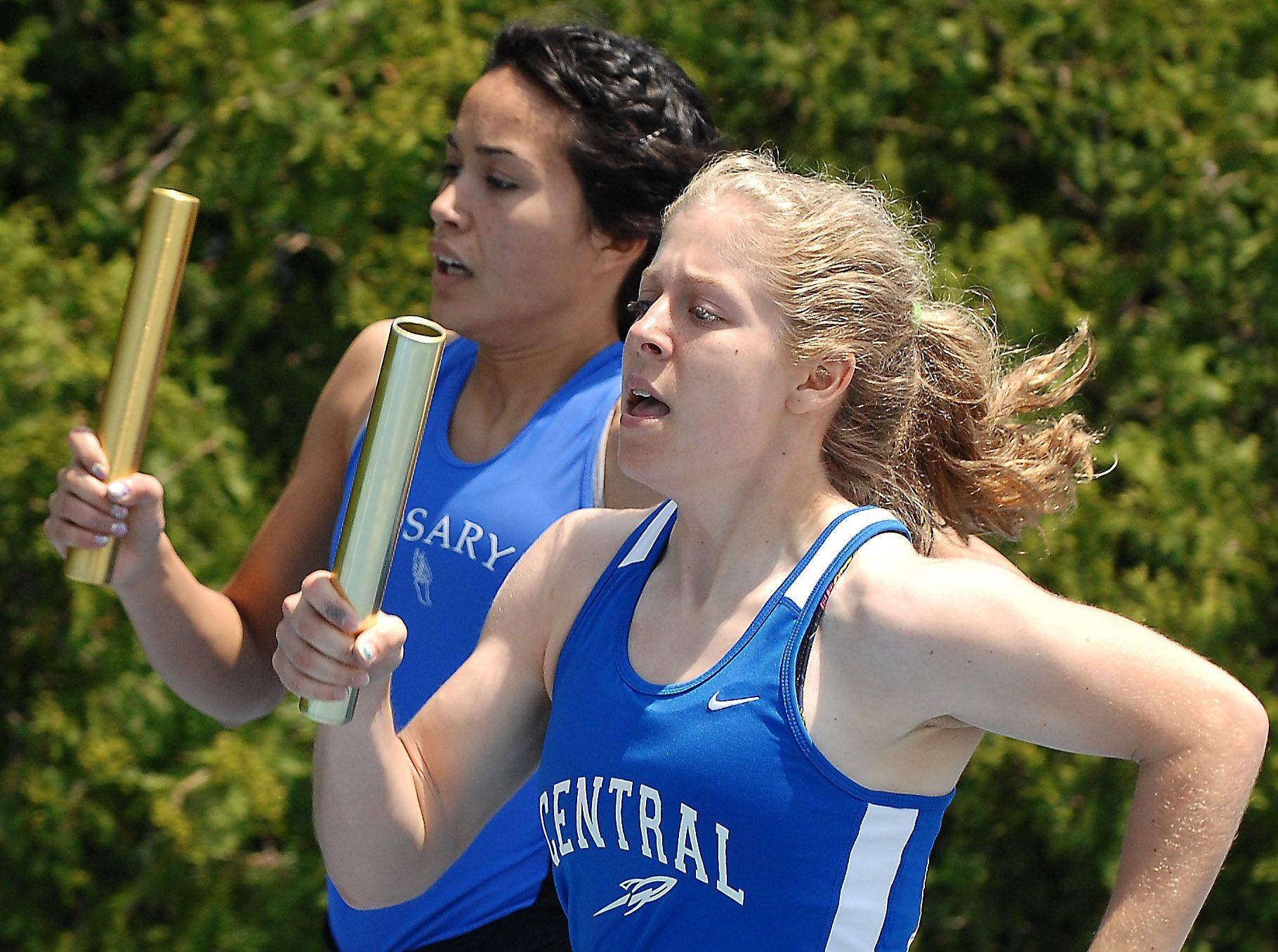 Burlington Central's Kayla Wolf and Rosary's Jessica Mejia run their legs of the 4x400-meter relay Friday in Charleston.
