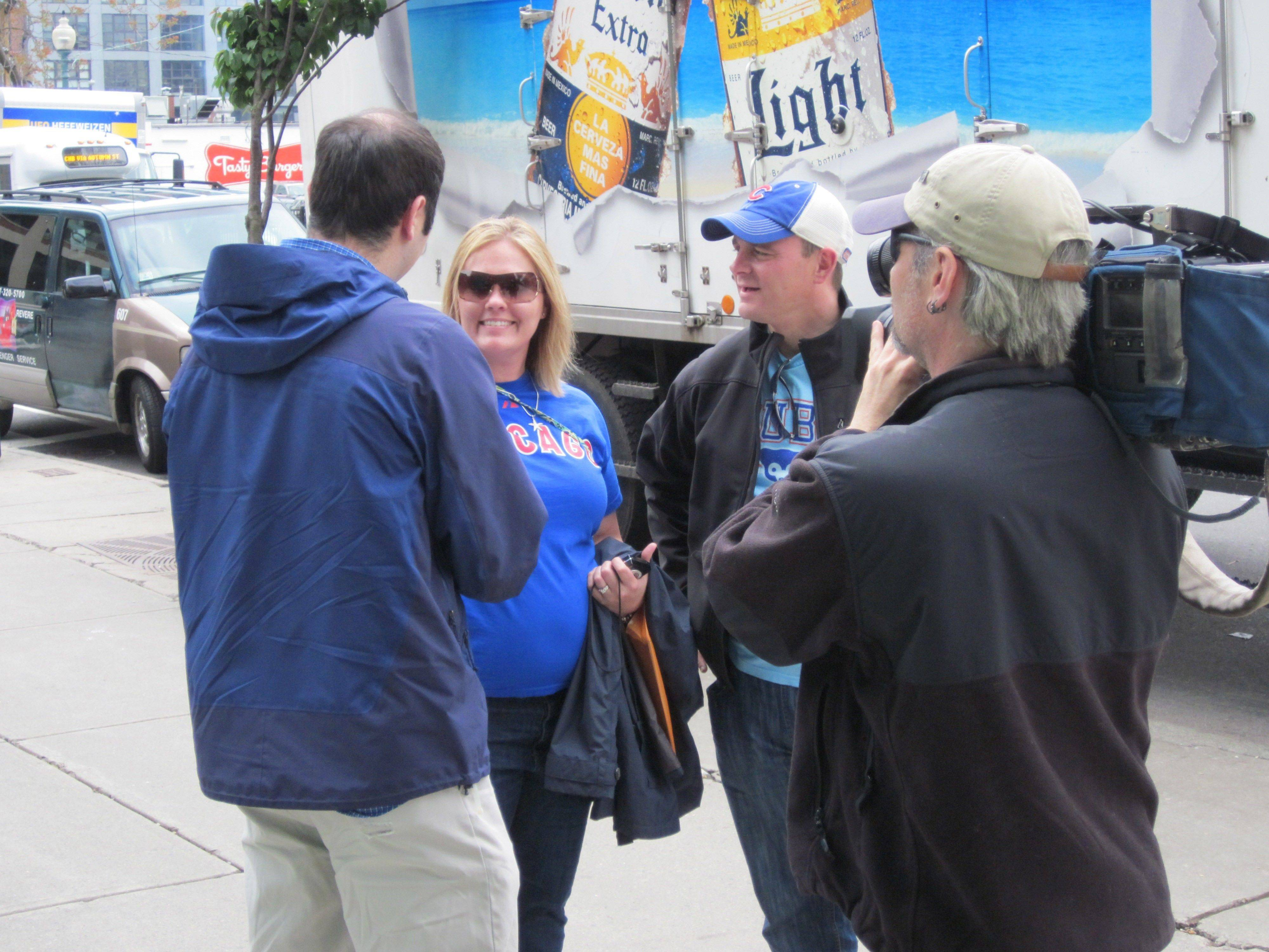 A television crew from a Boston station interviews Amanda and Tim Freidag of Schaumburg before the Cubs-Red Sox game Friday, May 20, at Fenway Park. It was the first time the Cubs had played at Fenway since the 1918 World Series.