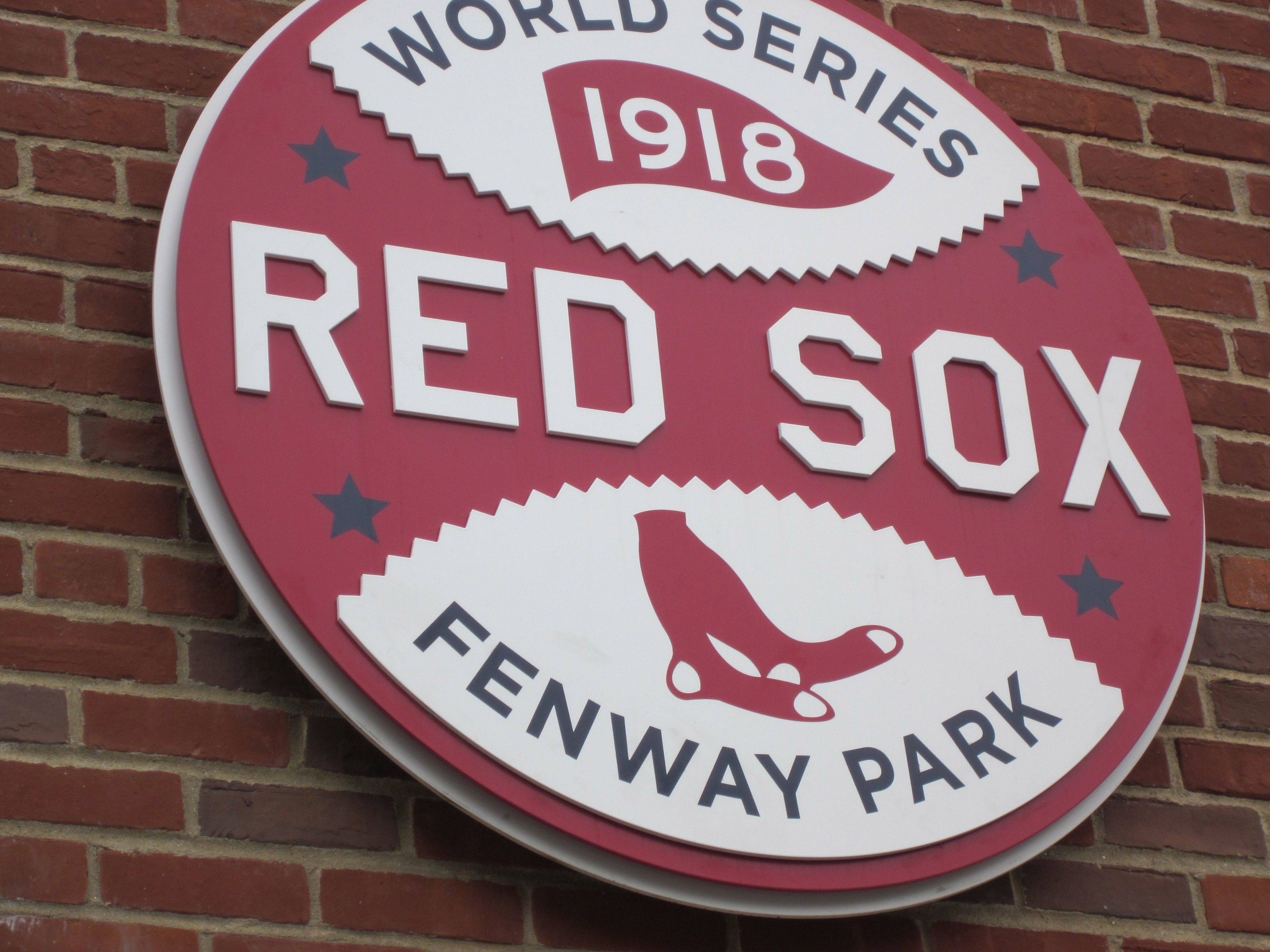 An emblem from the last time the Cubs and Red Sox met at Fenway Park, for the 1918 World Series, adorns the famed Boston ballpark. The Cubs played the Red Sox Friday, May 20, in a three-game series.