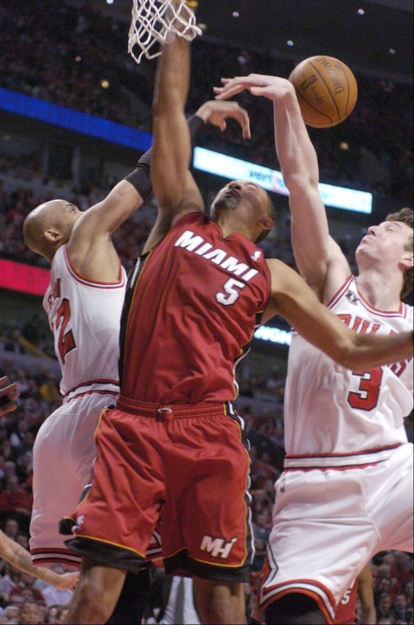 Juwan Howard of the Heat has his shot blocked as he goes to the basket against Taj Gibson, left, and Omer Asik of the Bulls during Game 2 of the Eastern Conference finals at the United Center on Wednesday.