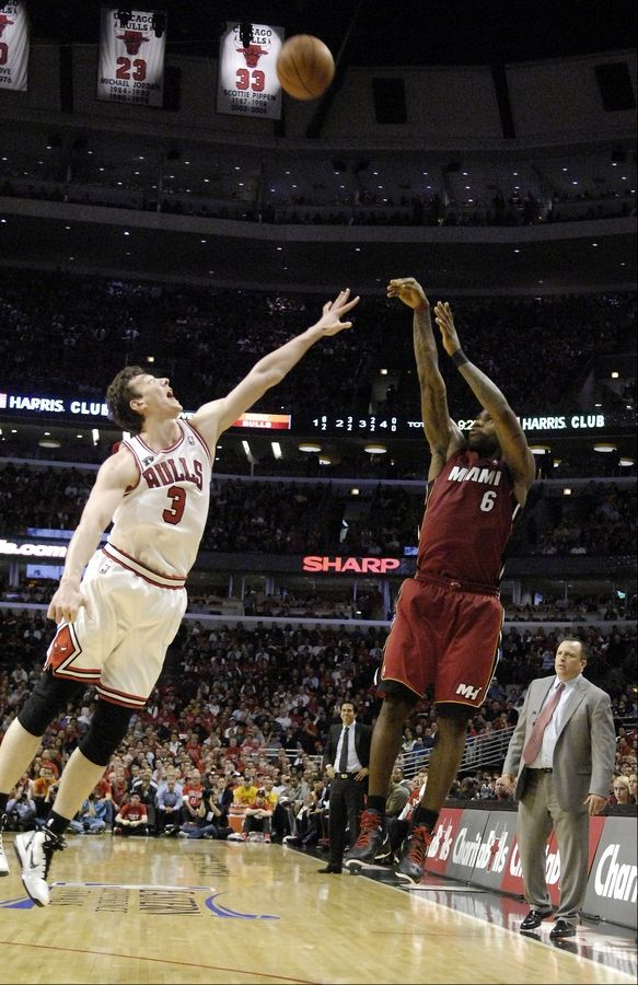 The Heat's LeBron James launches a 3-pointer over the Bulls' Omer Asik during Game 2 of the Eastern Conference finals at the United Center on Wednesday.