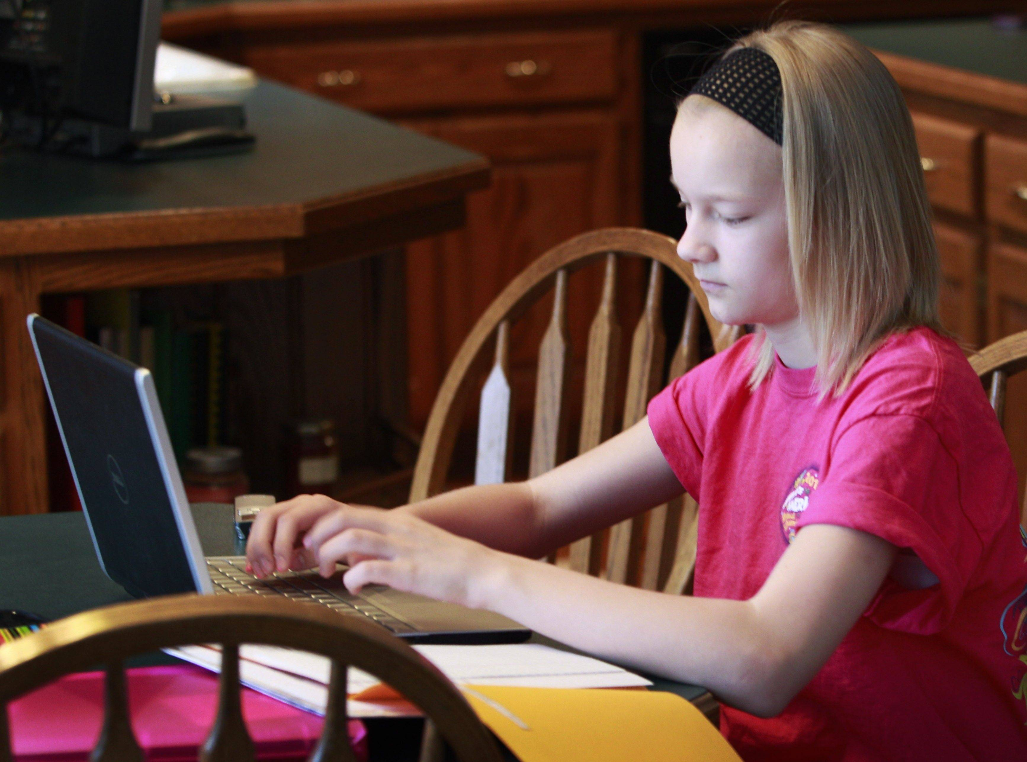 In early April, Cameron Mottet makes up a missed snow day in the kitchen of her home in Parkville, Mo. Some schools are experimenting with ways for students to do lessons online during bad weather, potentially allowing classes to go on during even the worst blizzard.
