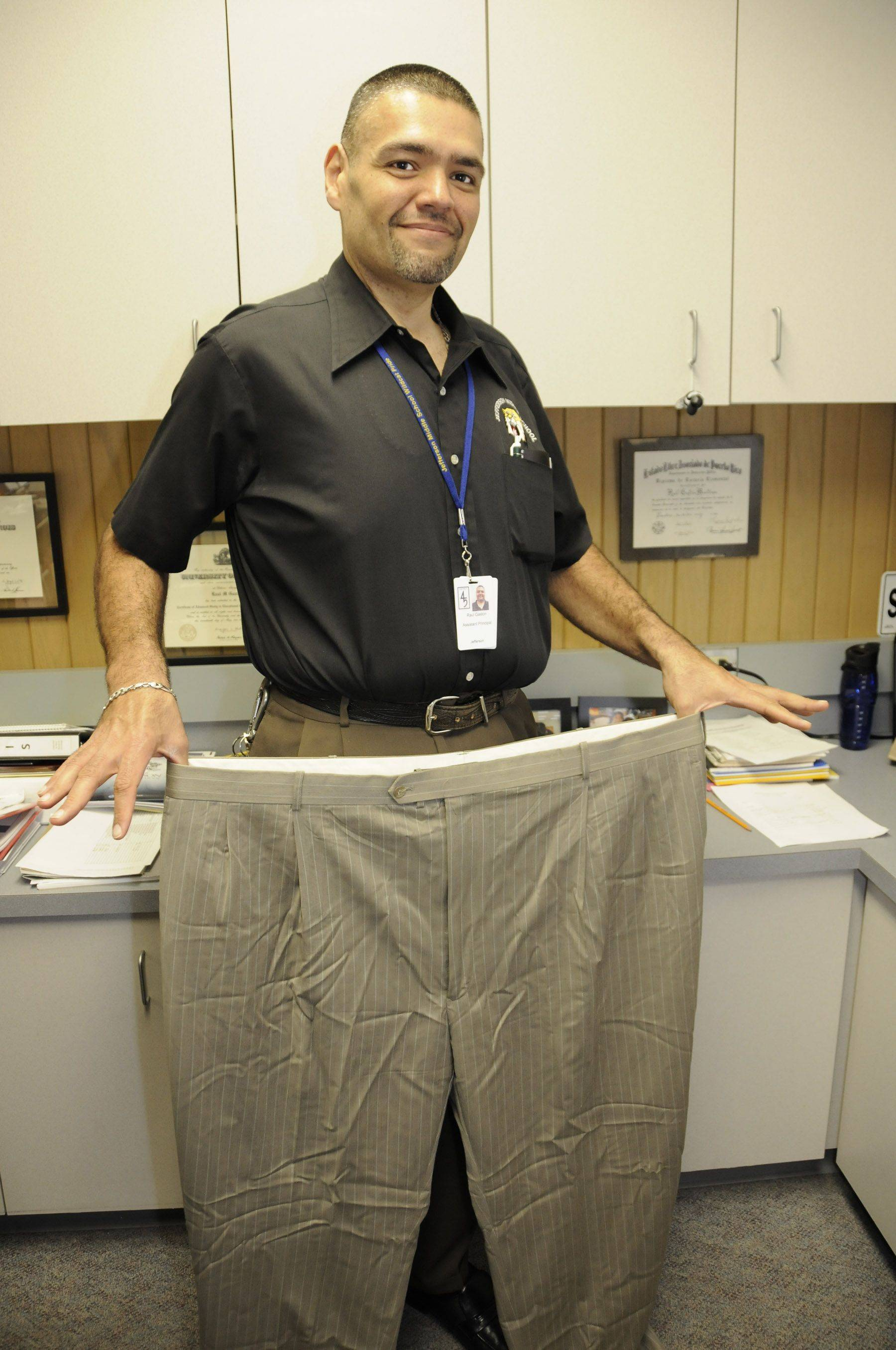 Ra�l Gast�n, assistant principal at Jefferson Middle School in Villa Park, shows the size 60 pants he used to wear before he lost 180 pounds in less than a year.