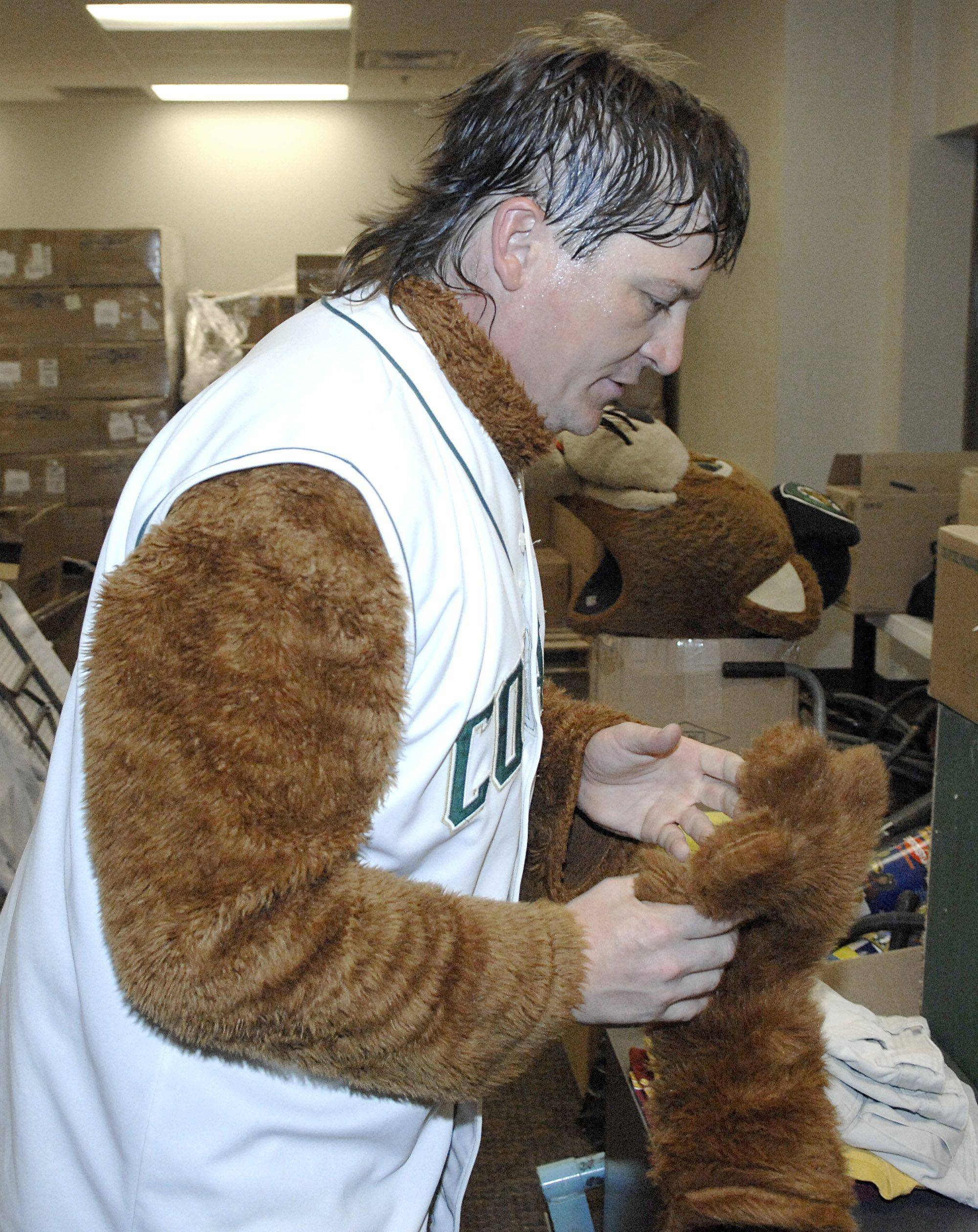 Drenched in sweat, Forrest removes his Ozzie Cougar head between innings so he can change his clothes underneath. Mike is constantly on the go, greeting and interacting with fans, so working up a sweat in the costume is easy, even on a cool early May evening.