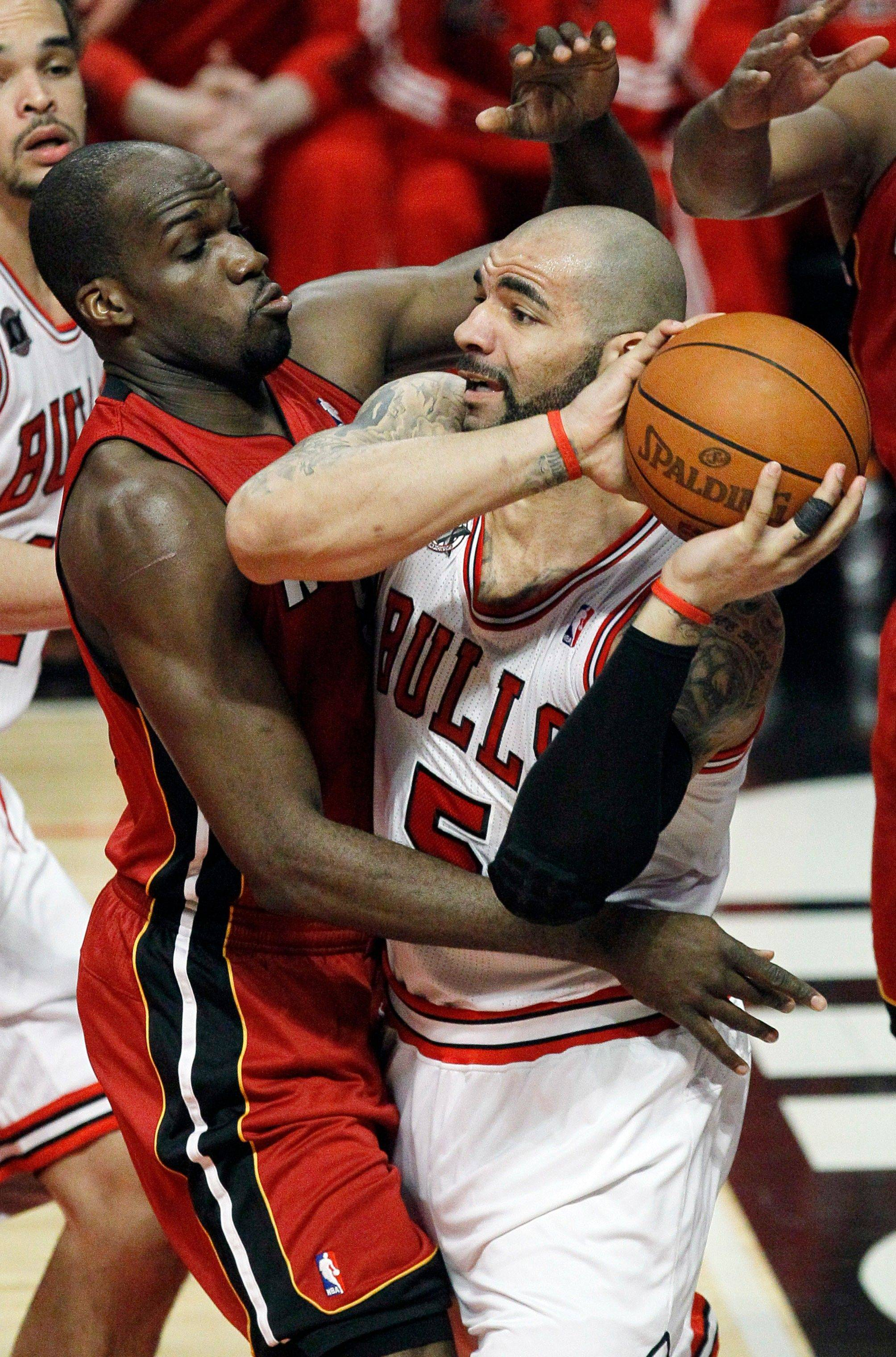 Carlos Boozer (5) looks to pass against center Joel Anthony during Game 2 of the Eastern Conference finals. Boozer has 21 points and 17 rebounds in the series' first two games.